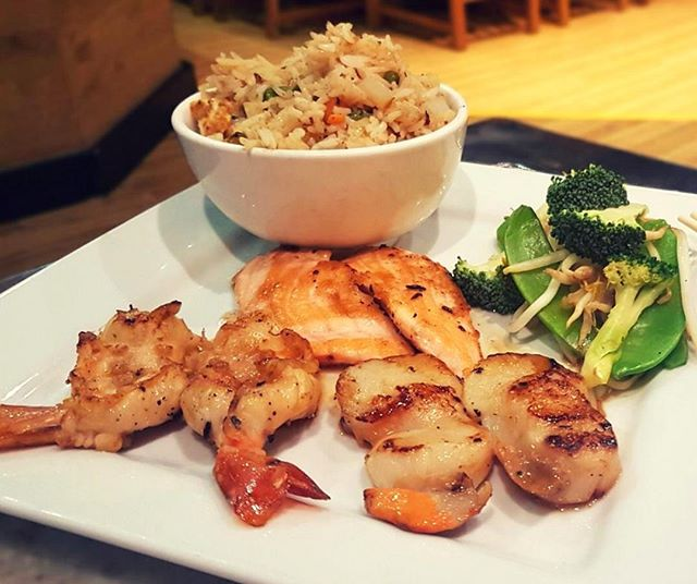 A must for seafood fans. 😍 . Featured: The Seafood Combo Special - King Prawns, Salmon & Scallops served with Fried Rice and Mixed Vegetables.