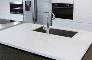 Quartz, which is also a natural stone, contains resins & glues. It is sturdy and not porous. Also, there are a variety of colors & patterns that are consistent to choose from.