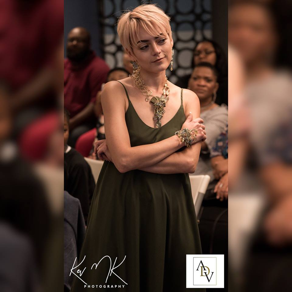 Model wearing rainbow pyrite and gemstone statement necklace