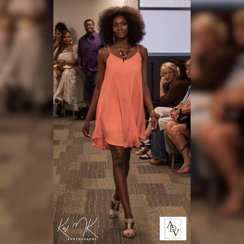 Model wearing gemstone statement necklace