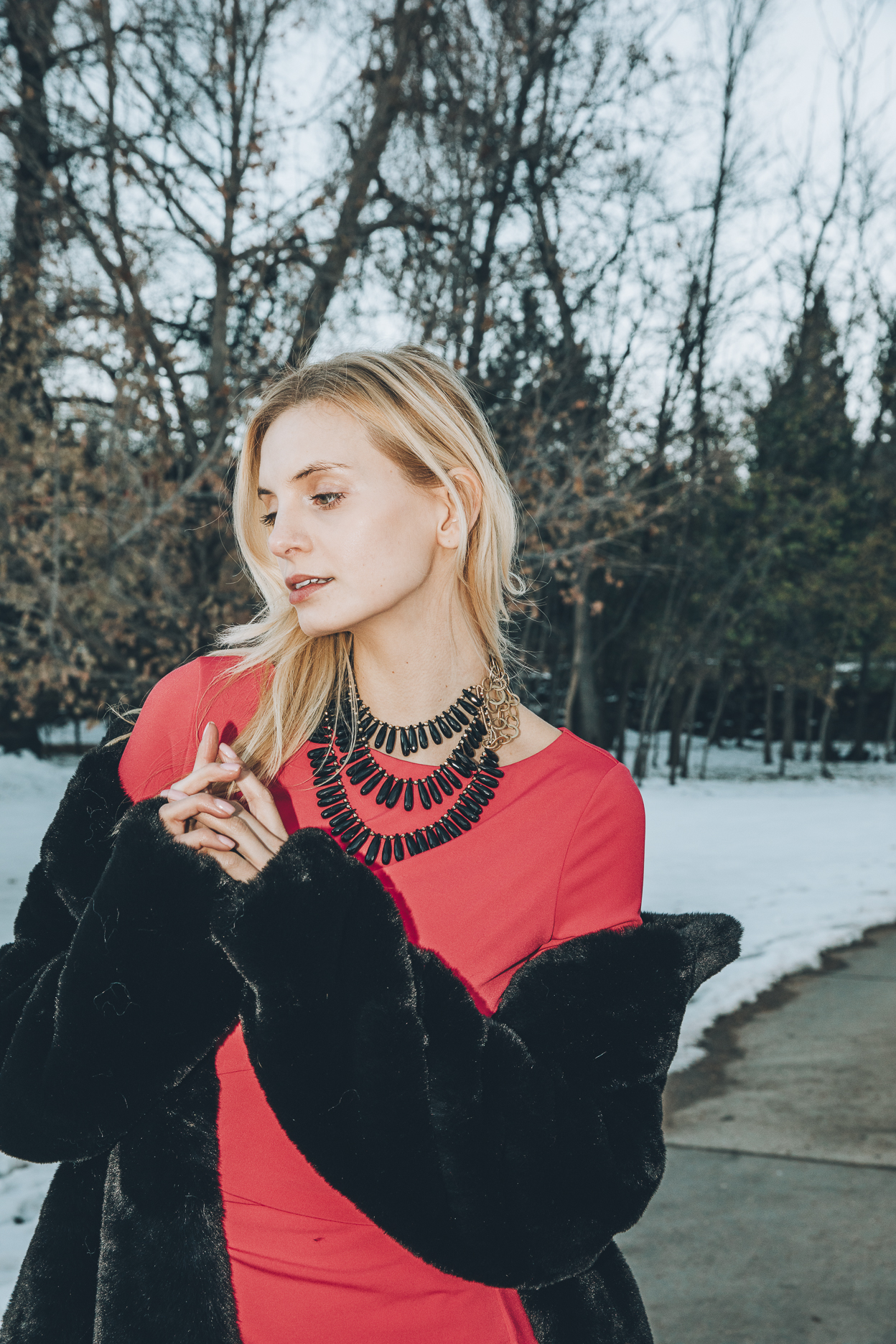 Model wearing a triple strand black spinel collar necklace