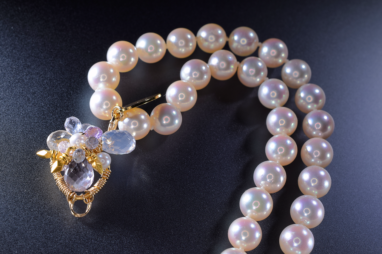 multi strand pearl necklace with gemstone accents