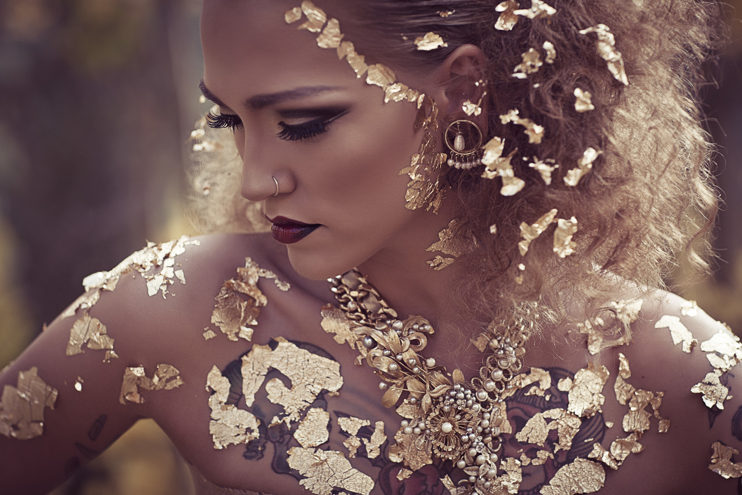 Model wearing gold and pearl vintage assemblage statement necklace