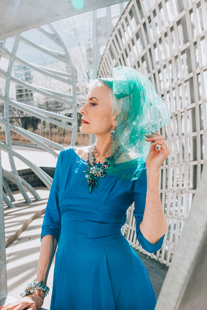 Advanced style blogger Style Crone wearing a statement beetle wing and gemstone necklace