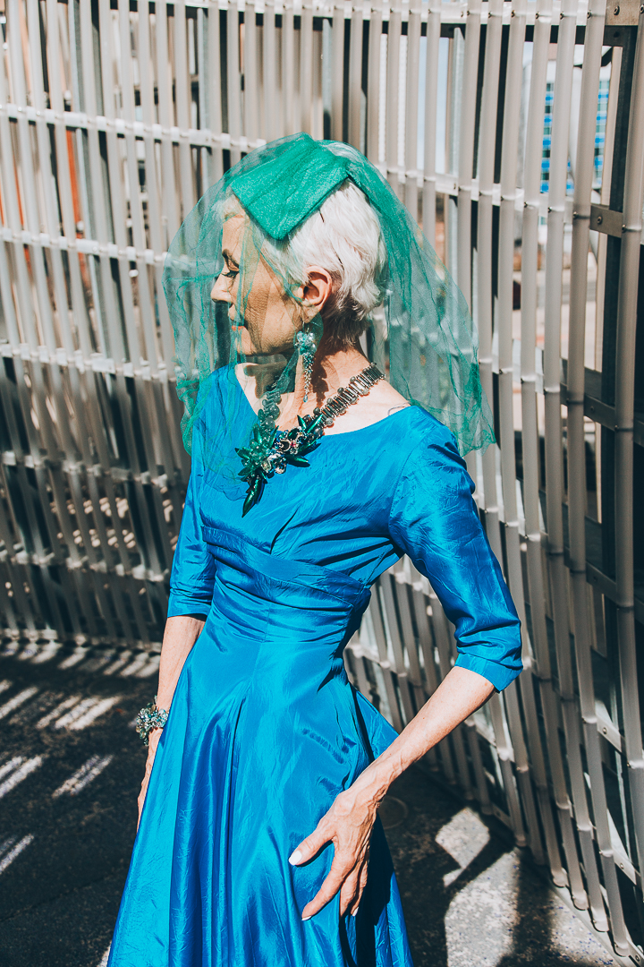 Advanced style blogger Style Crone wearing gemstone and silver earrings