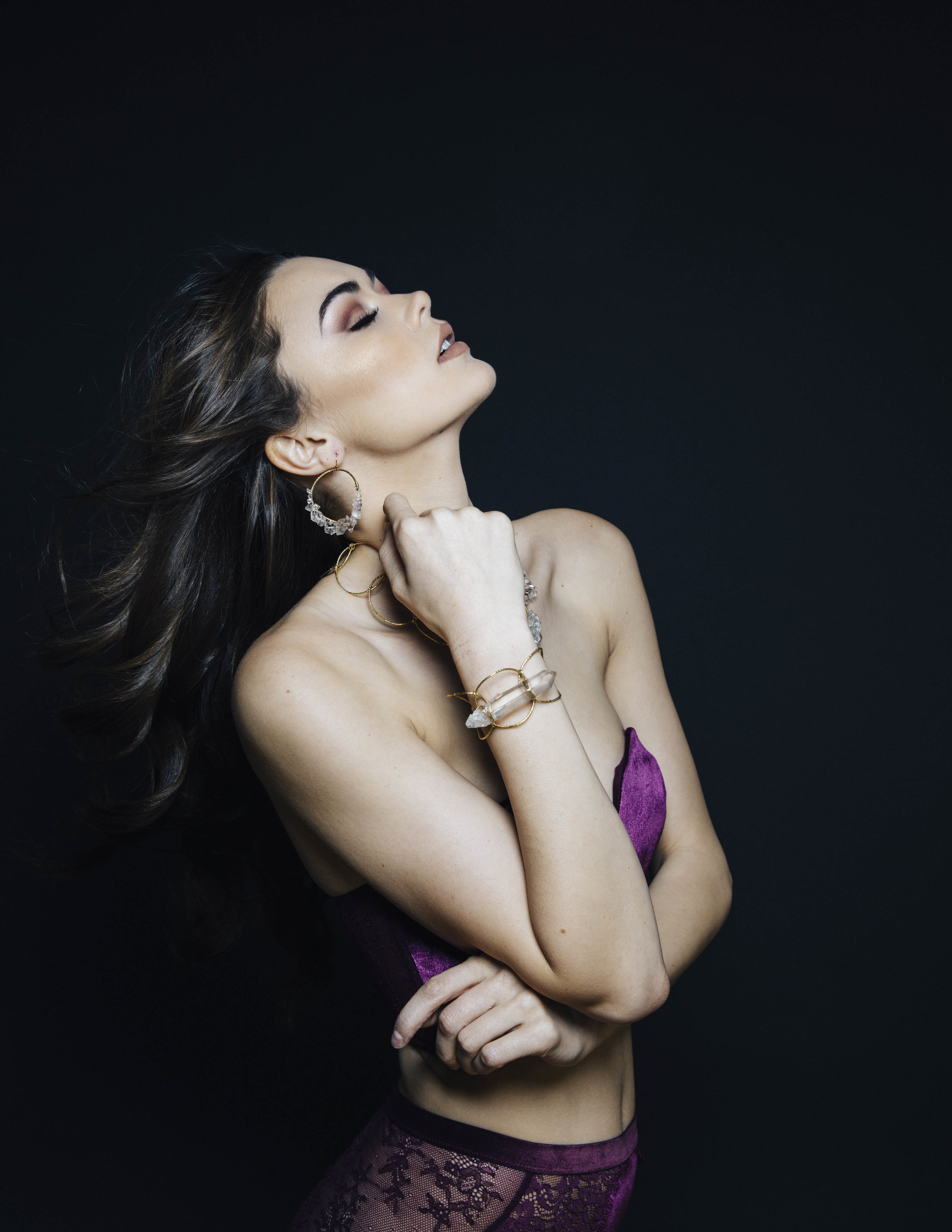 Model wearing crystal point cuff bracelet