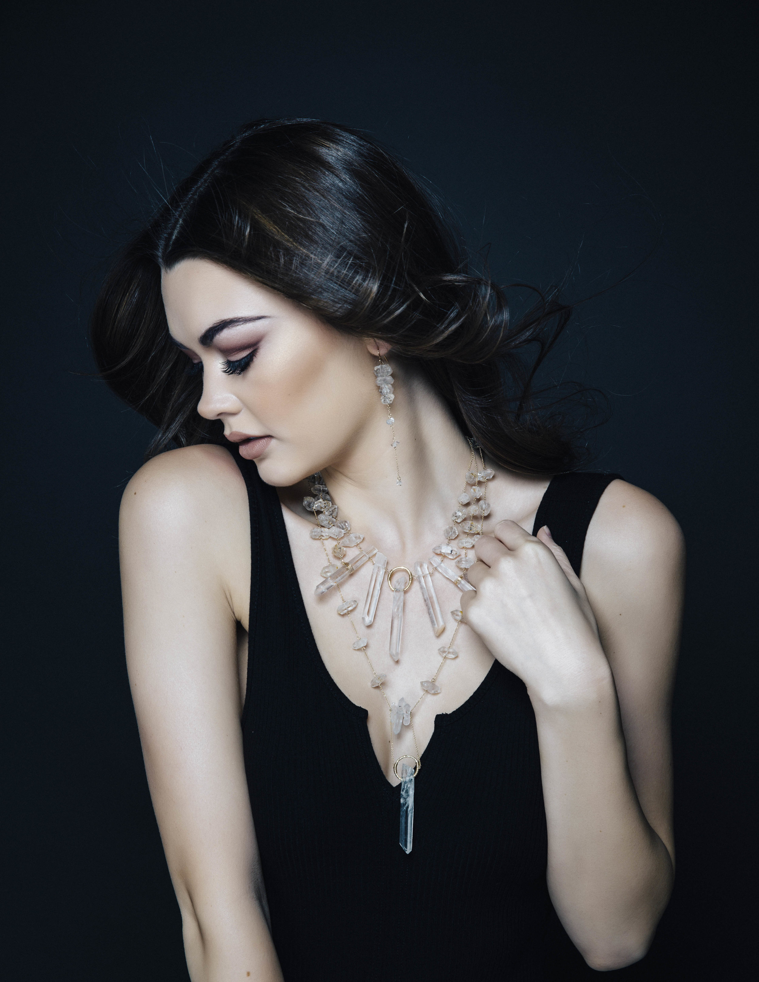 Model wearing a crystal point statement necklace