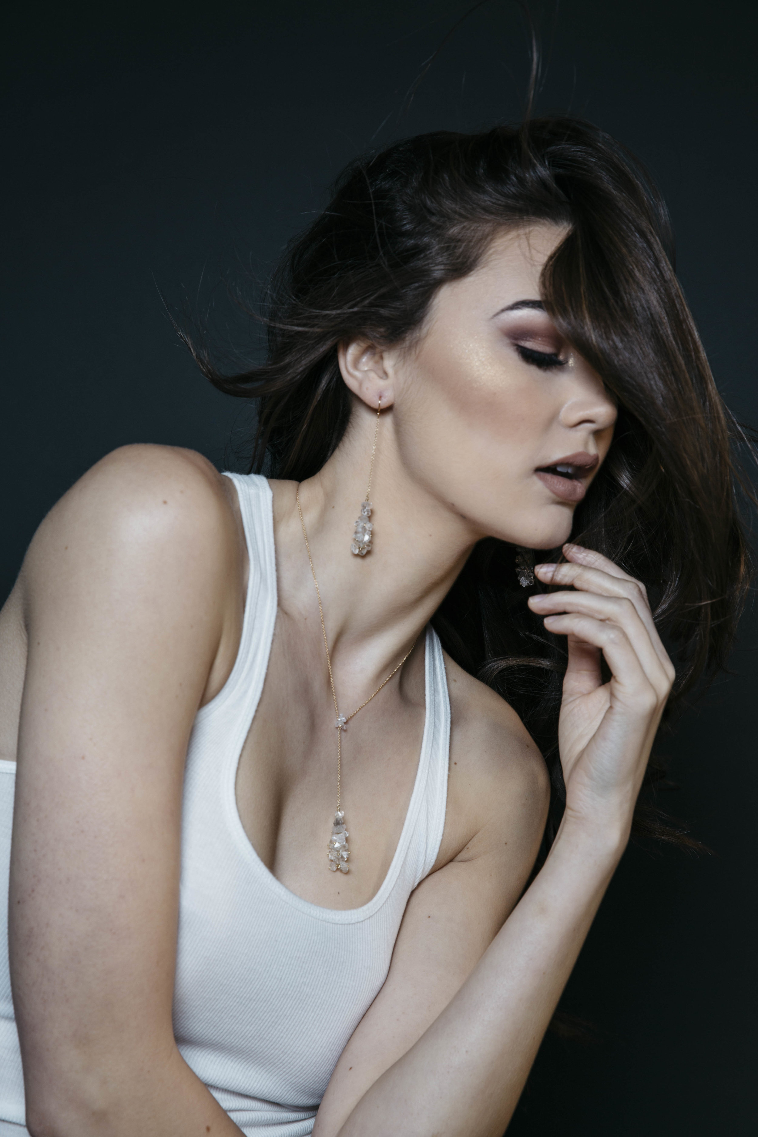 model wearing long pendant crystal drop earrings