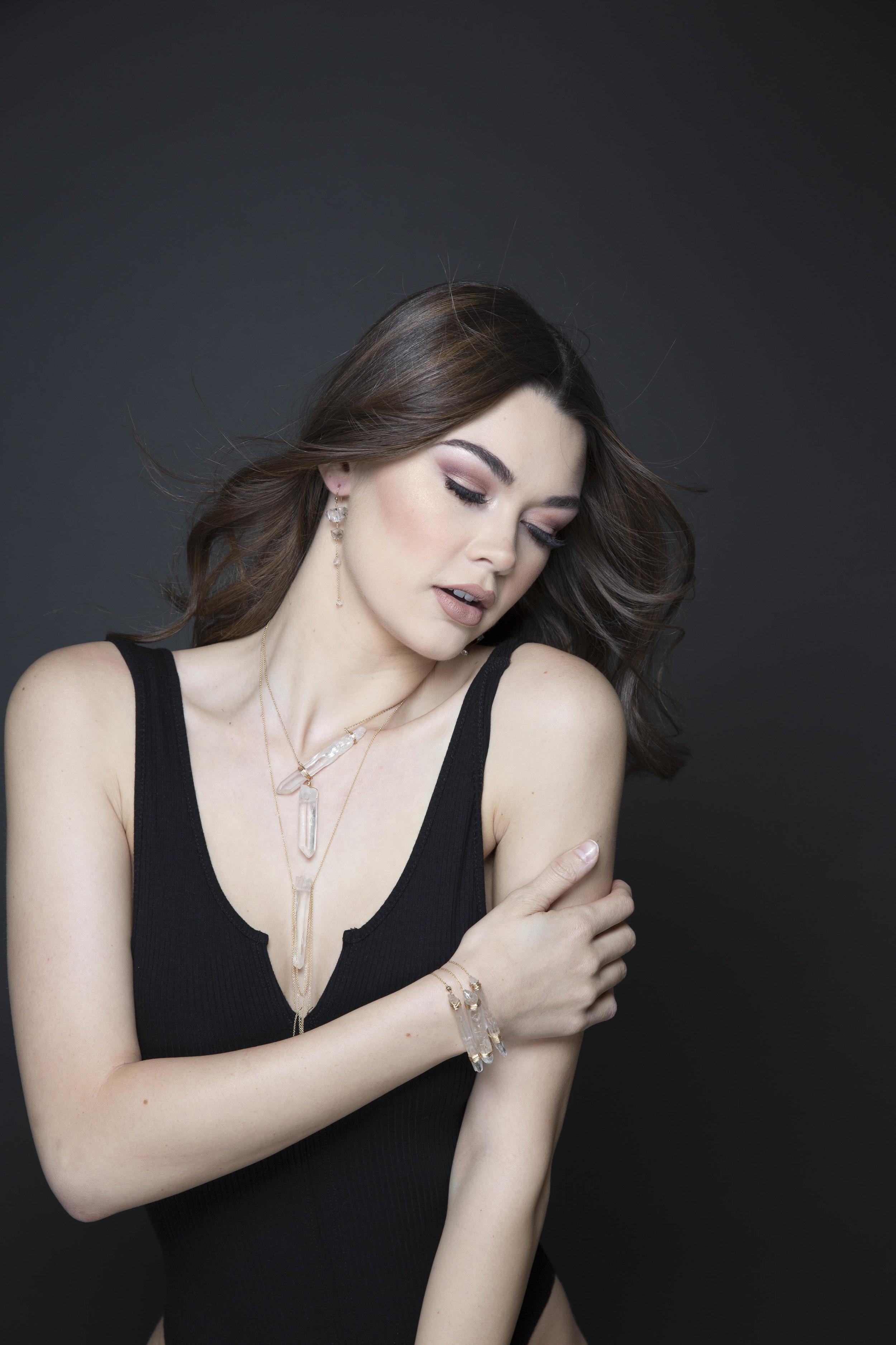 model wearing a crystal point wrap bracelet