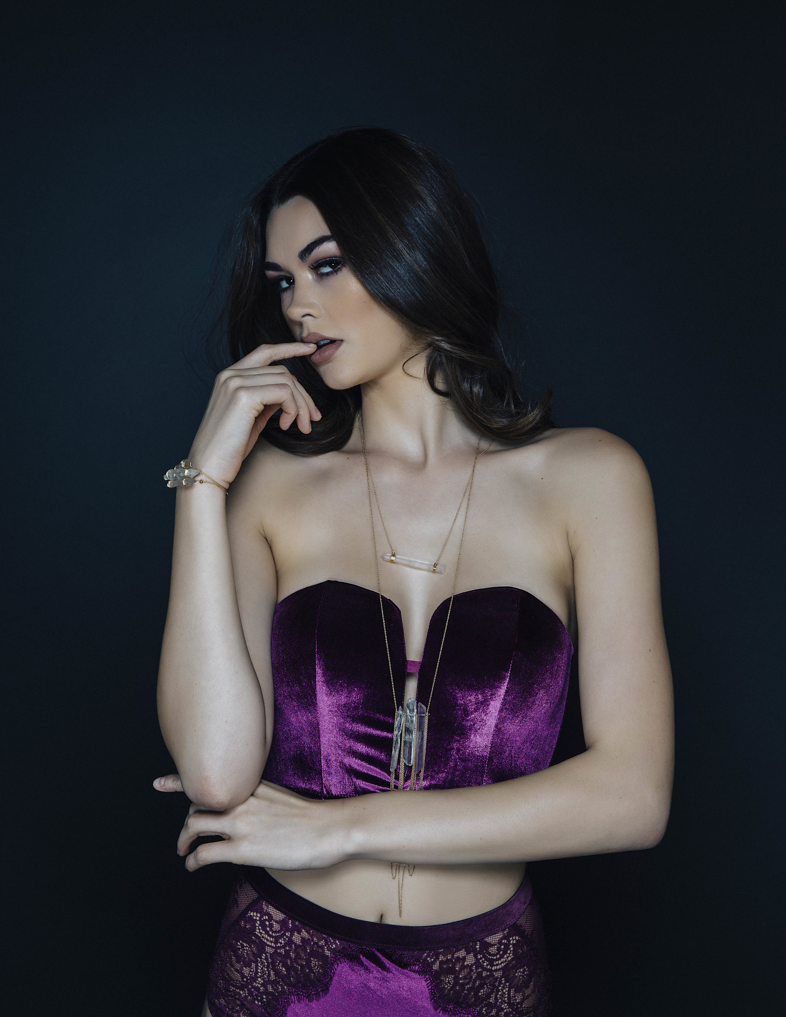 model wearing a crystal point horizontal bar necklace