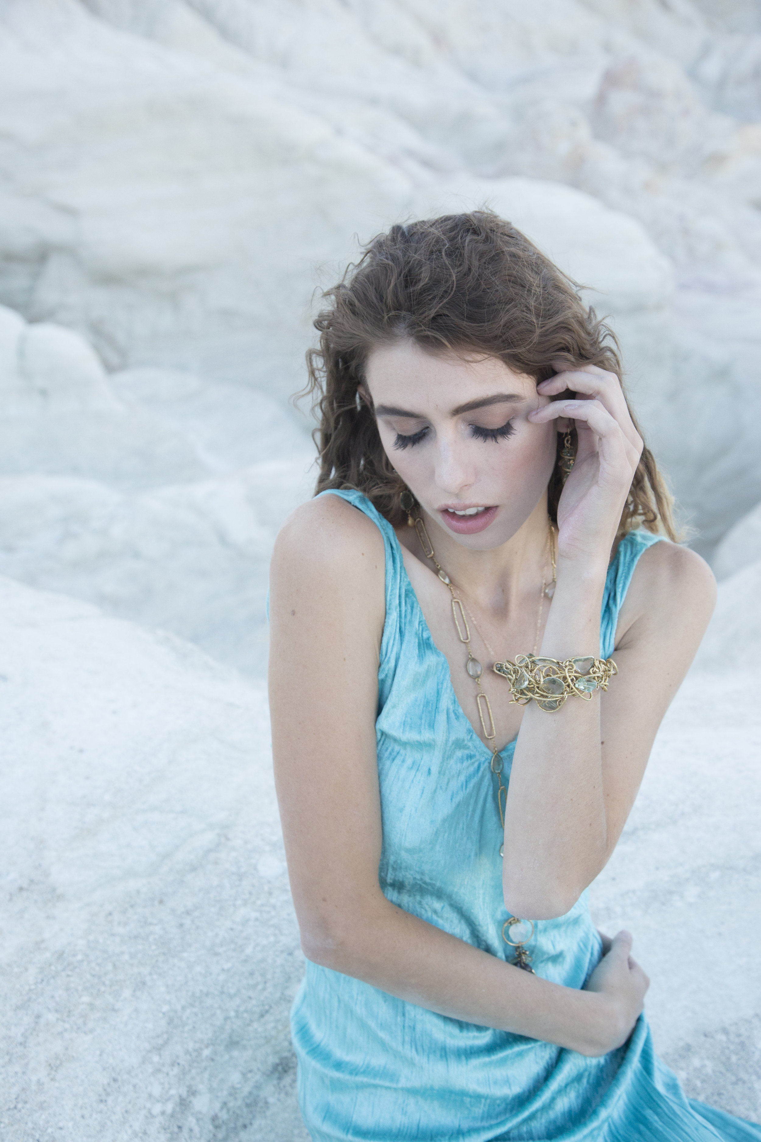 model wearing a gemstone and gold bar necklace