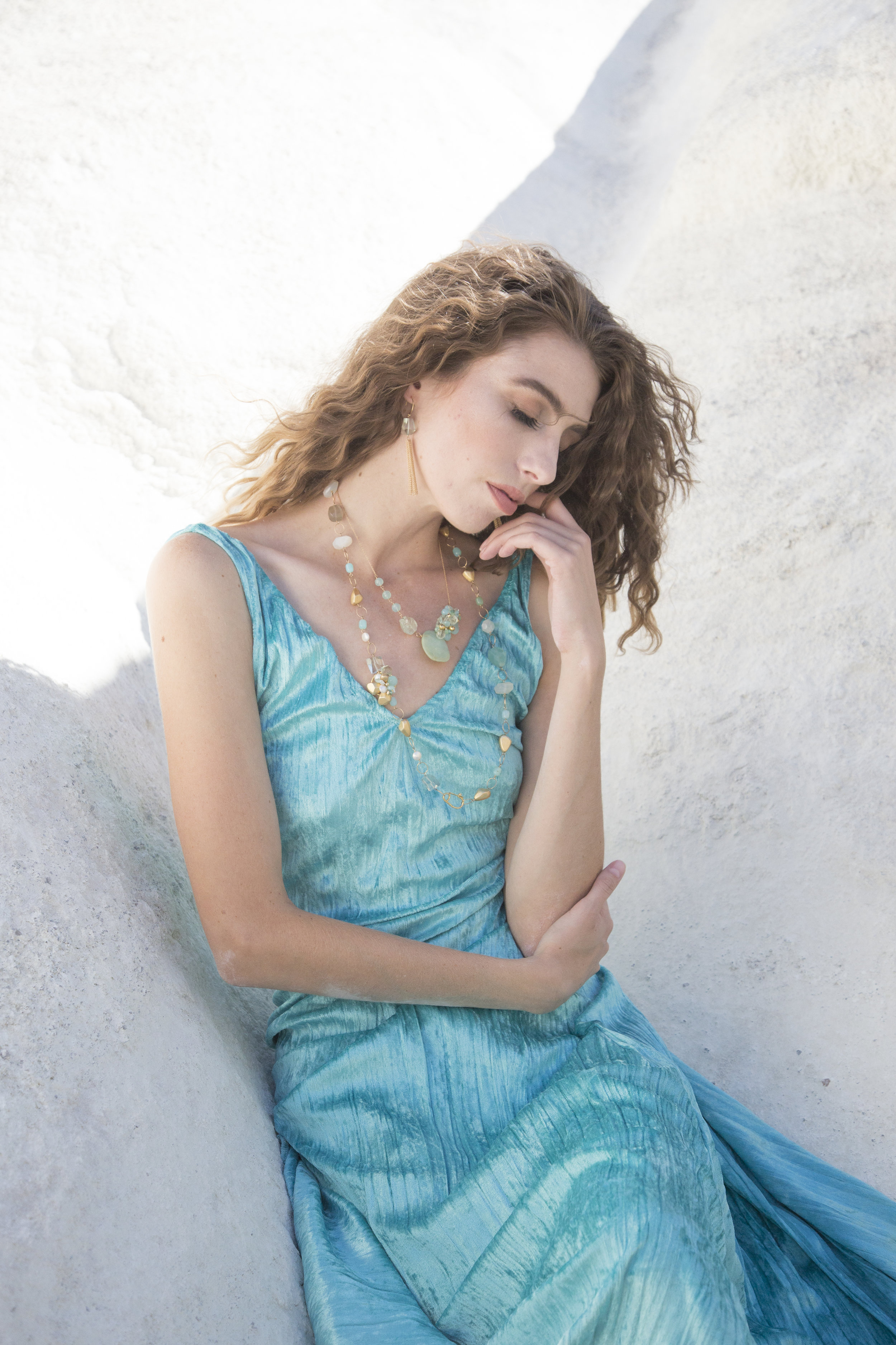 model wearing a peruvian opal and aquamarine nugget with gold necklace