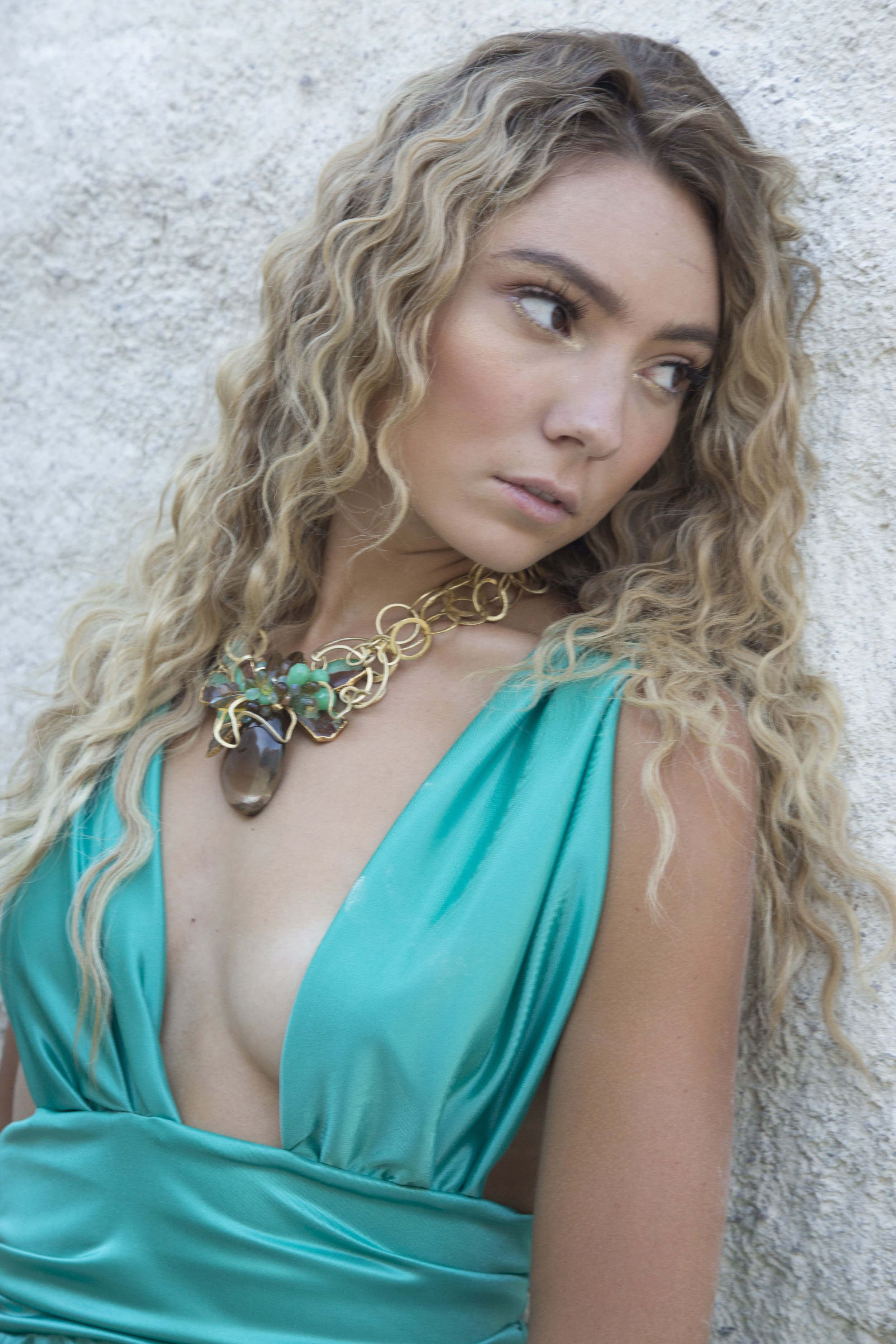 model wearing a statement smoky topaz pendant with gold link necklace
