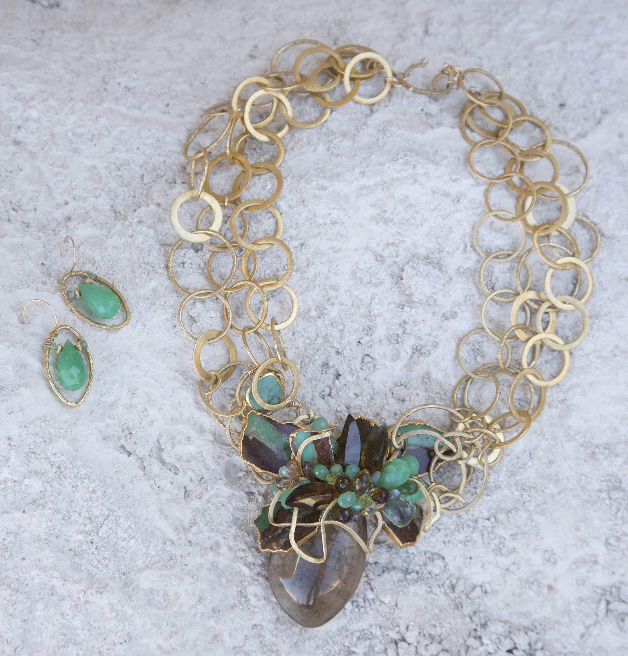 statement necklace with a large smoky topaz pendant with gold link chains