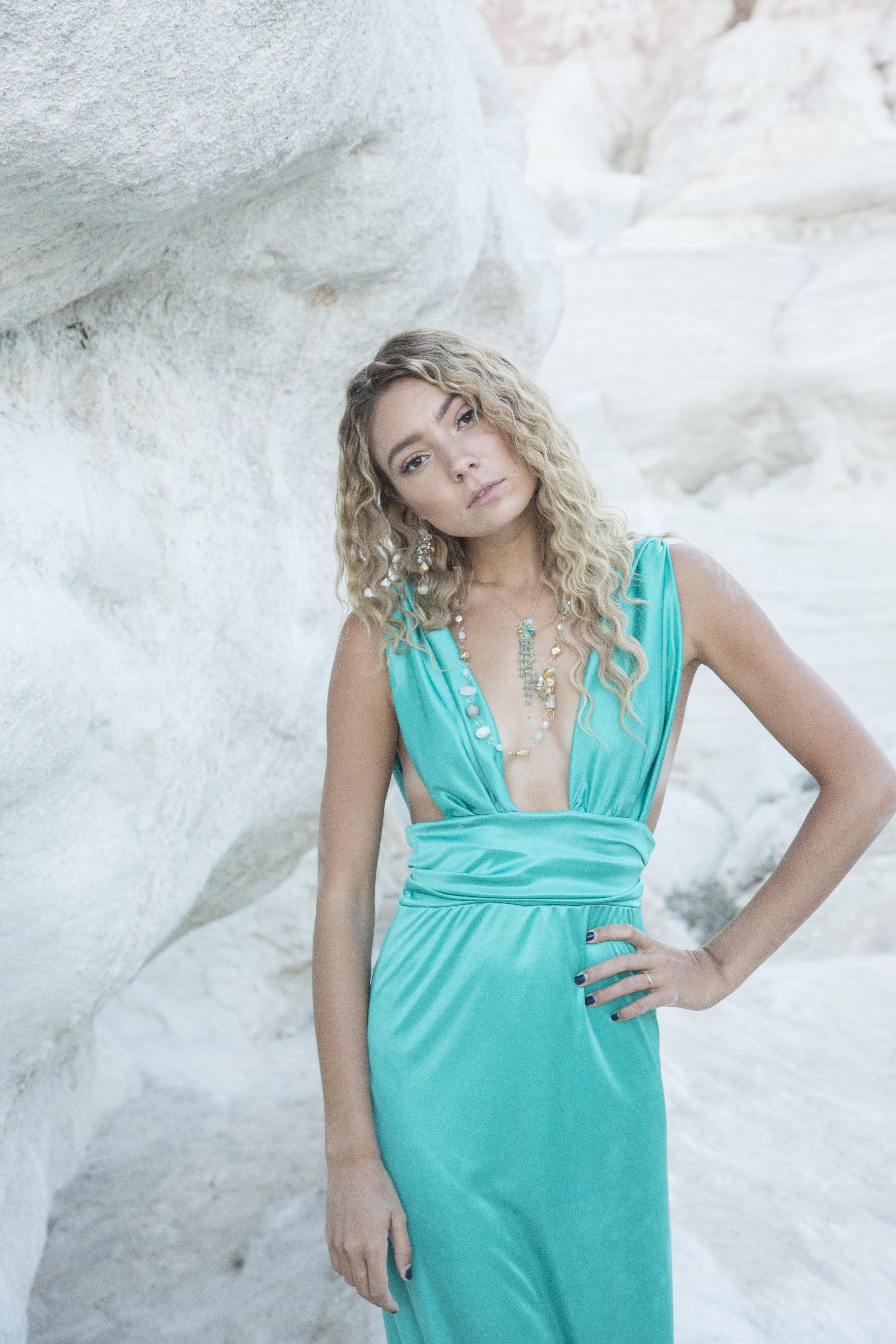 model wearing long gemstone layering necklace