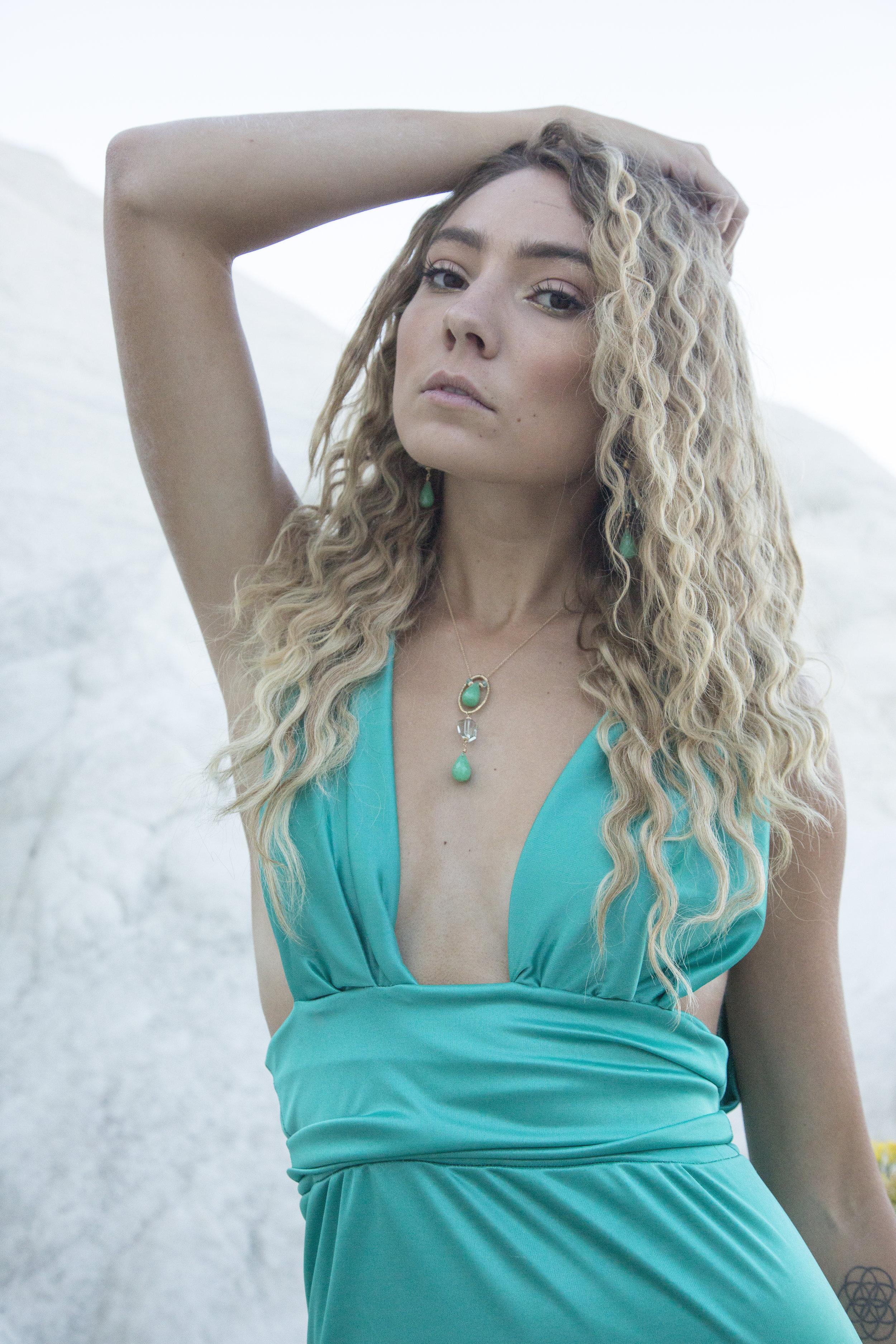 model wearing chrysoprase and green amethyst long drop earrings