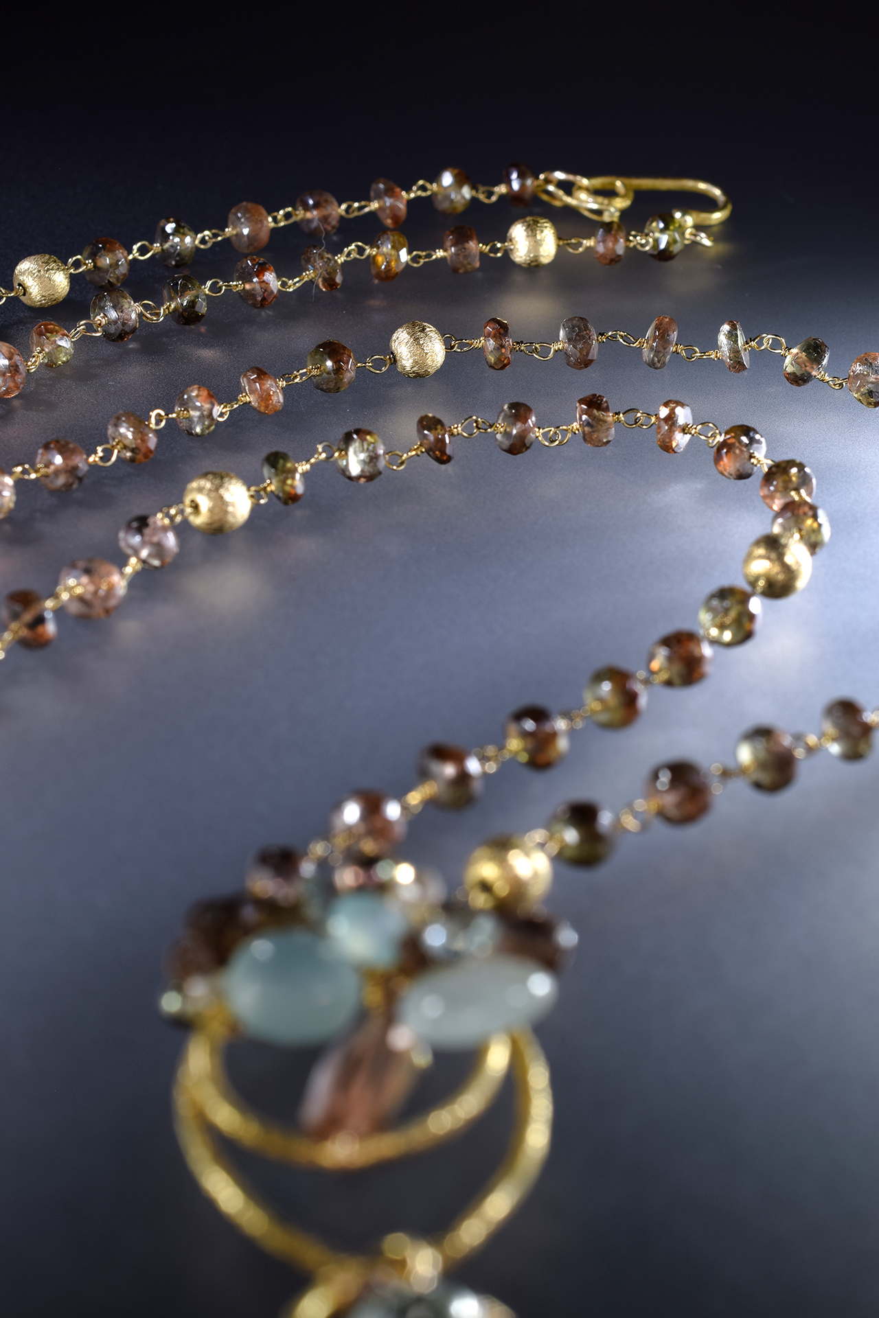 Long gold and gemstone necklace