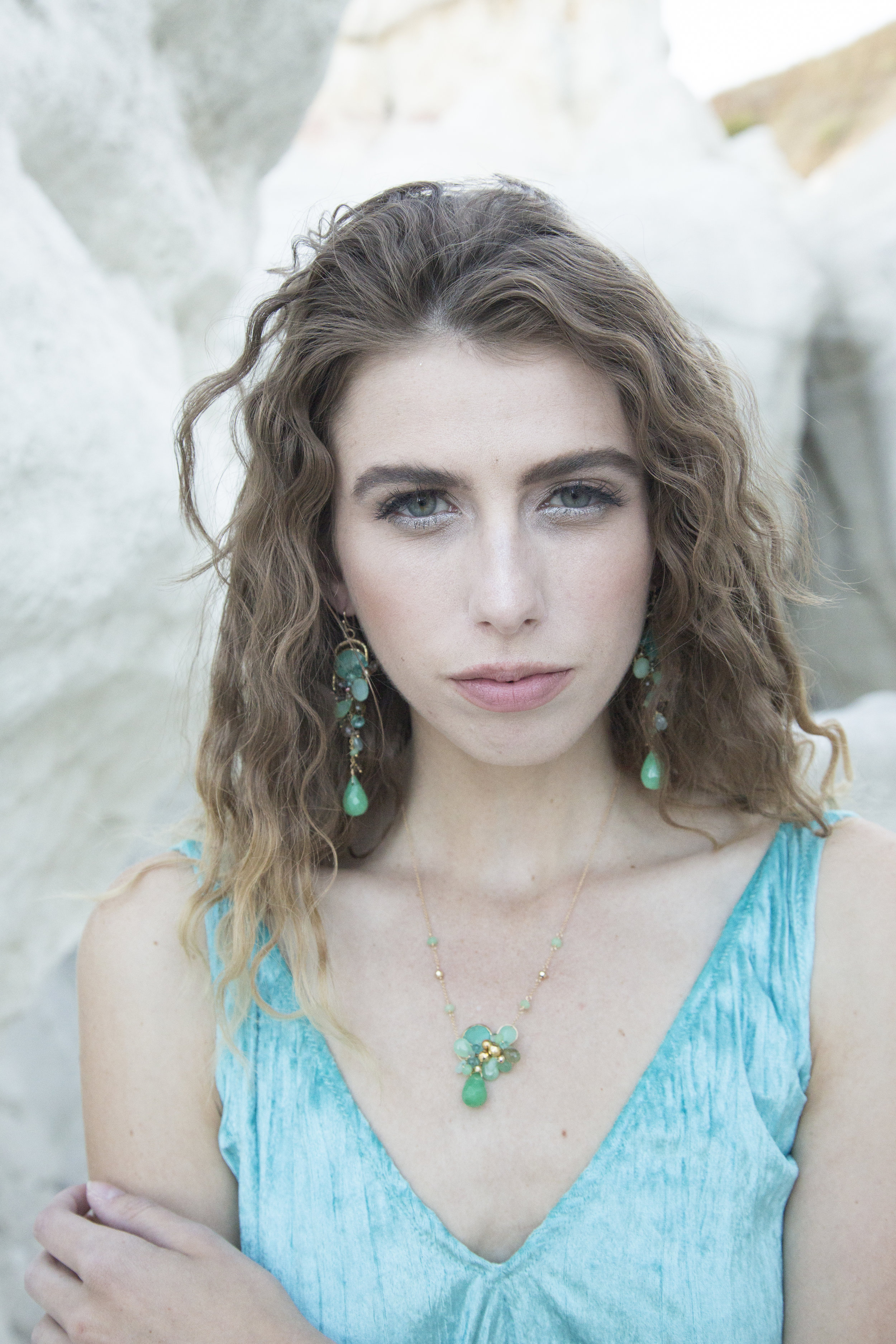 model wearing a chrysoprase and gemstone necklace