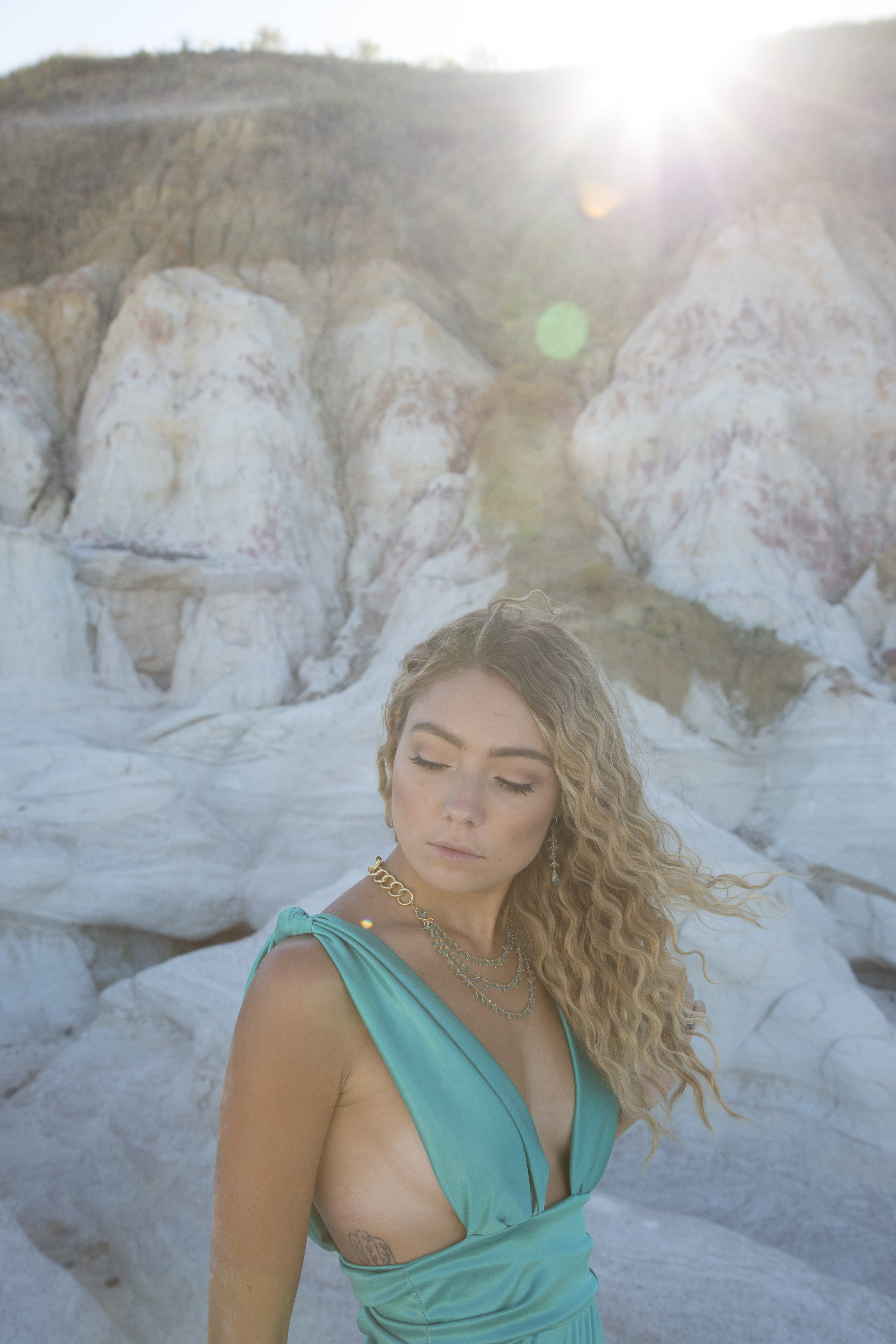 model wearing a multi-strand apatite gemstone necklace