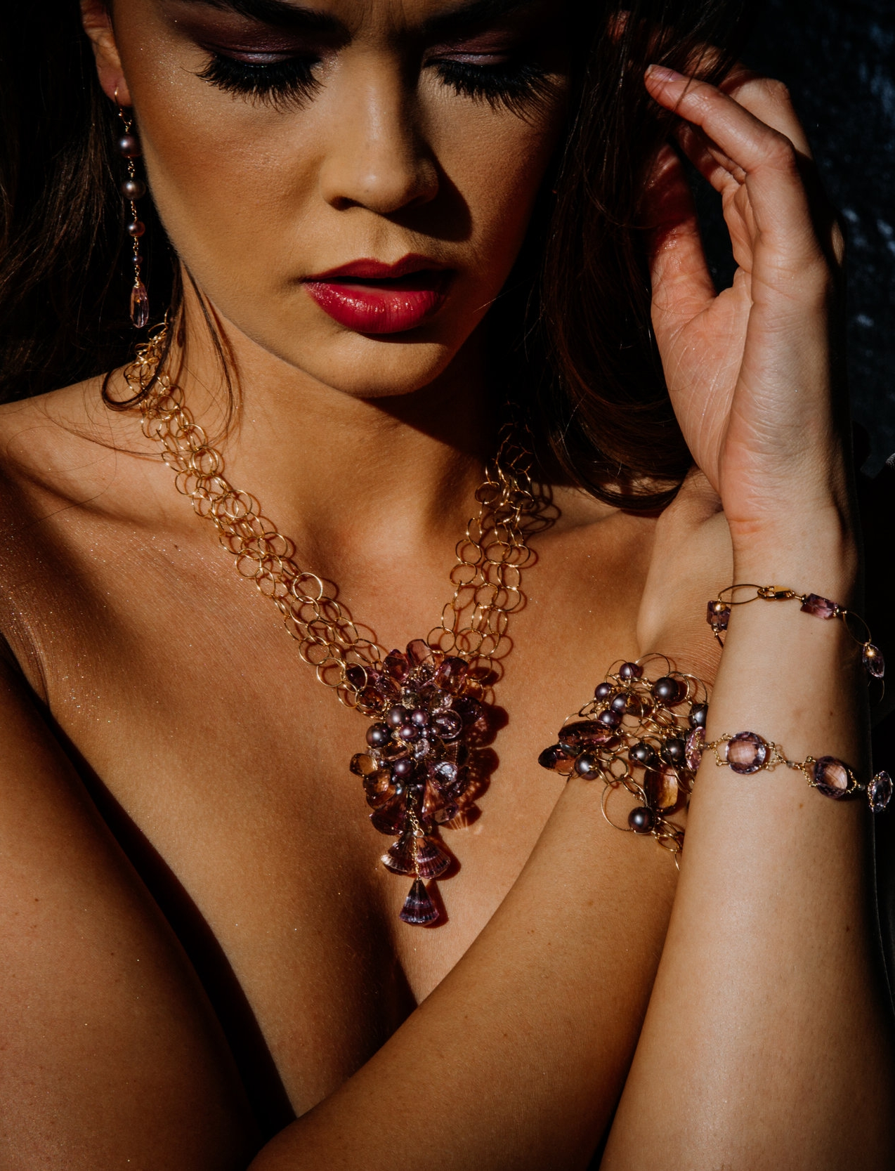 model wearing amethyst, ametrine and pearl statement necklace
