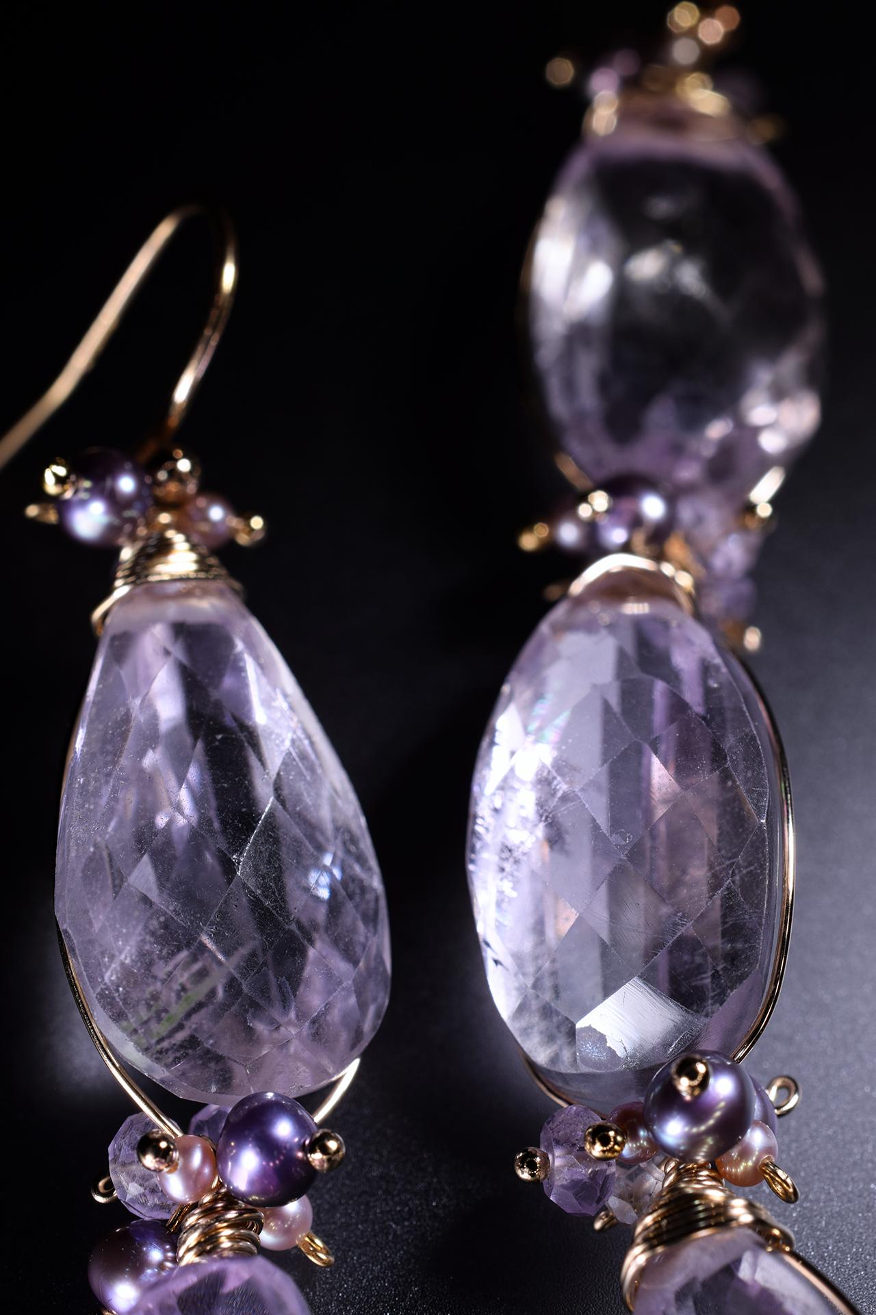 Details of pink amethyst and pearl drop earrings
