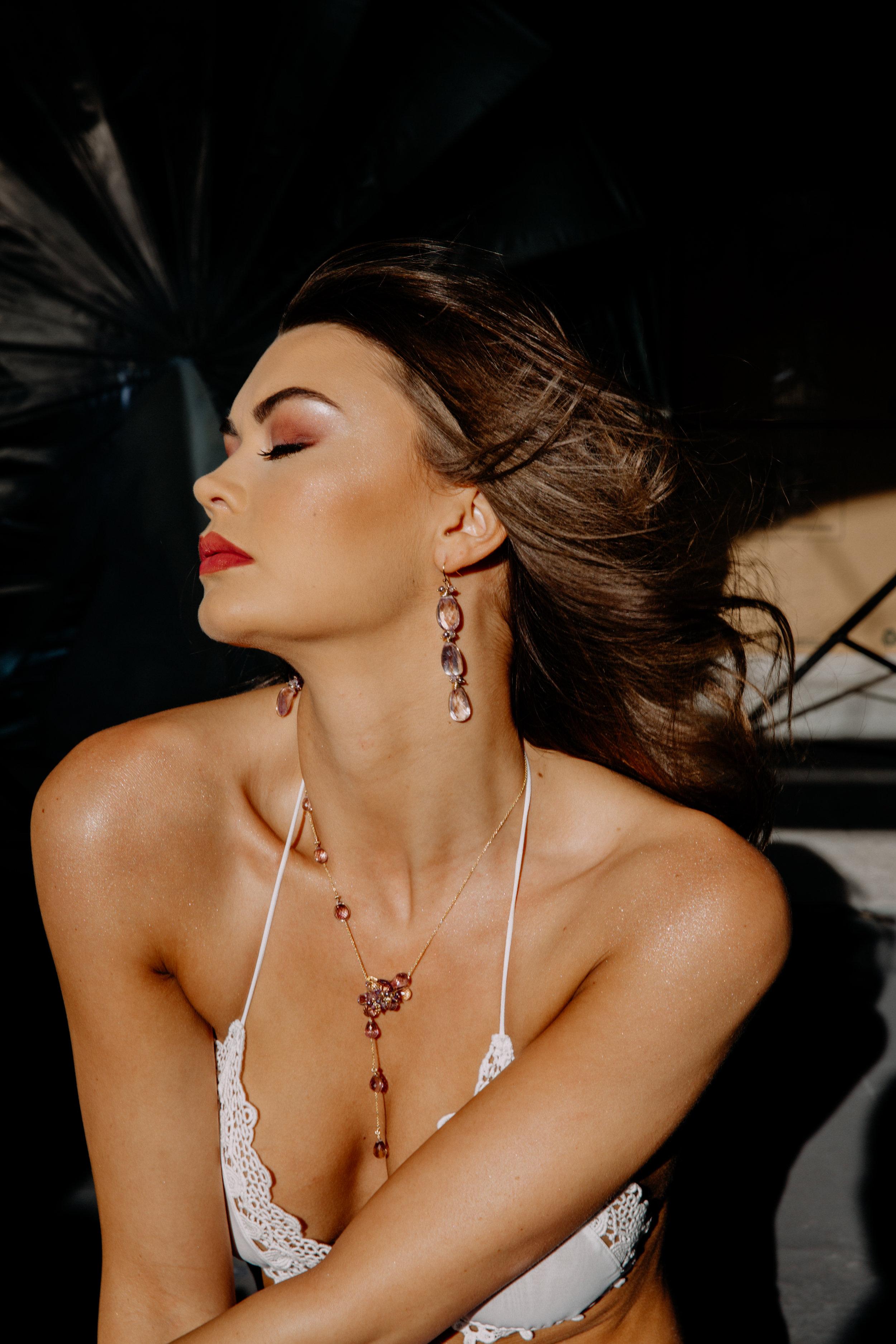 model wearing pink amethyst drop earrings
