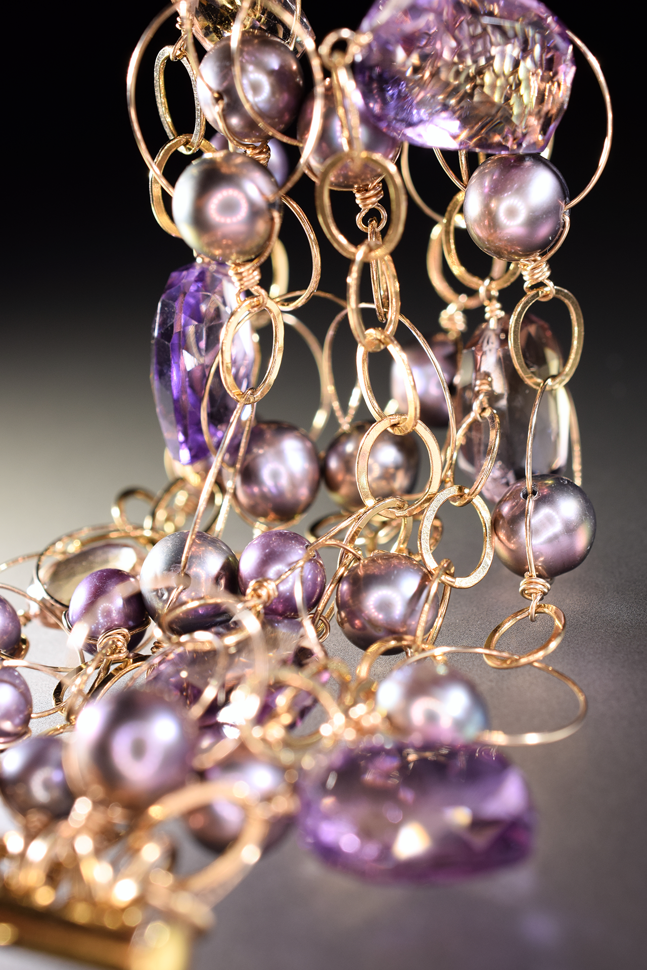 details of ametrine, pearl and gold link statement cuff bracelet