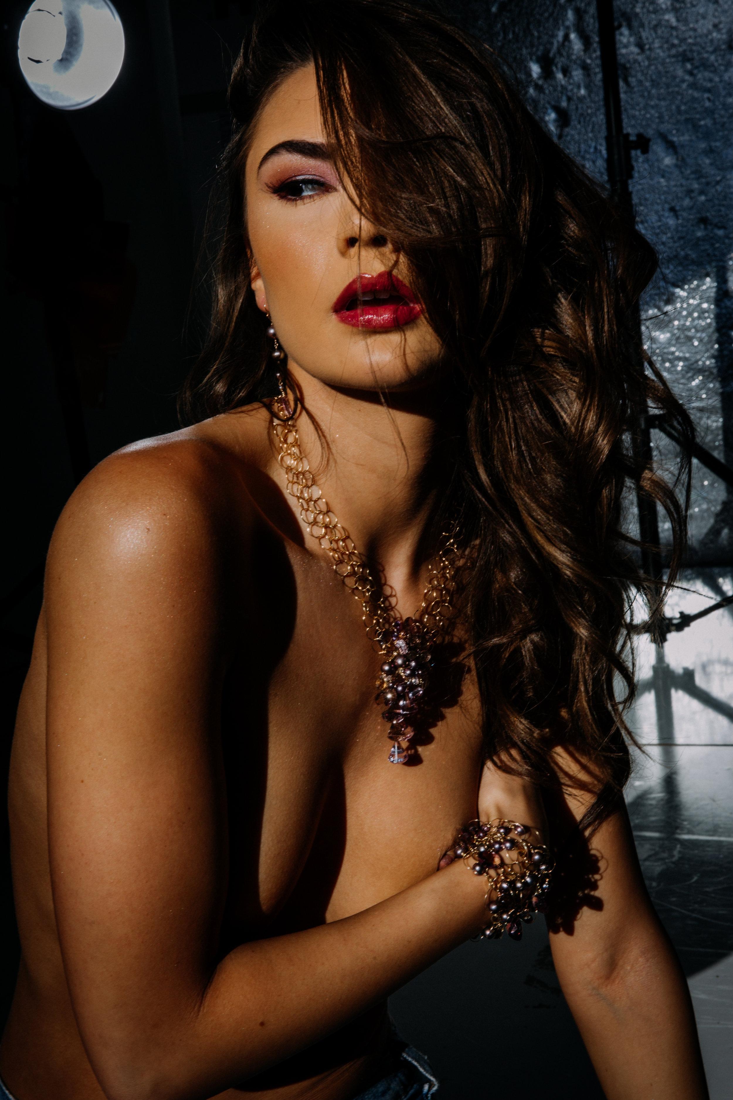 model wearing ametrine pearl and gold link statement cuff bracelet