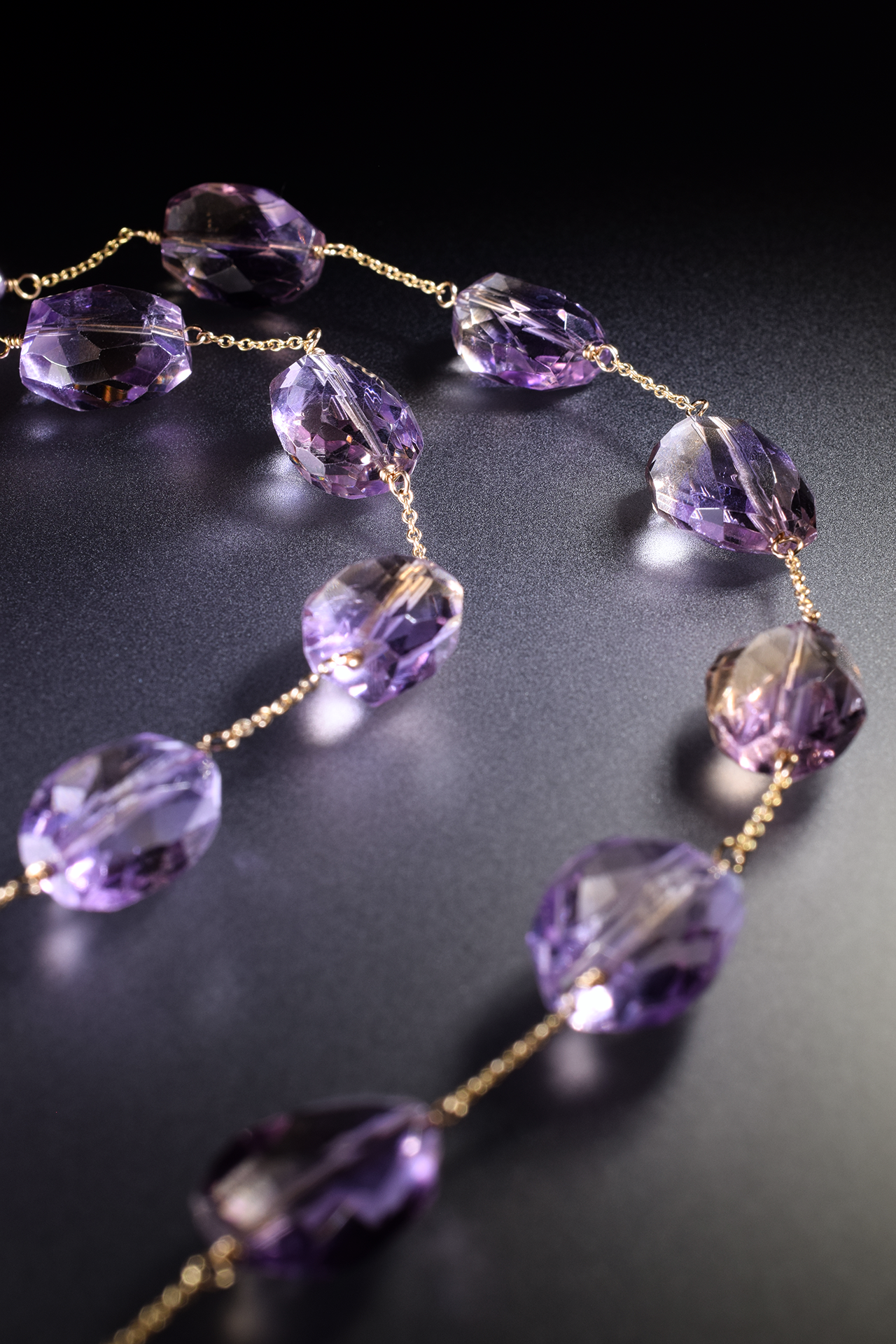 details of a pink amethyst ametrine and pearl multi drop pendant necklace