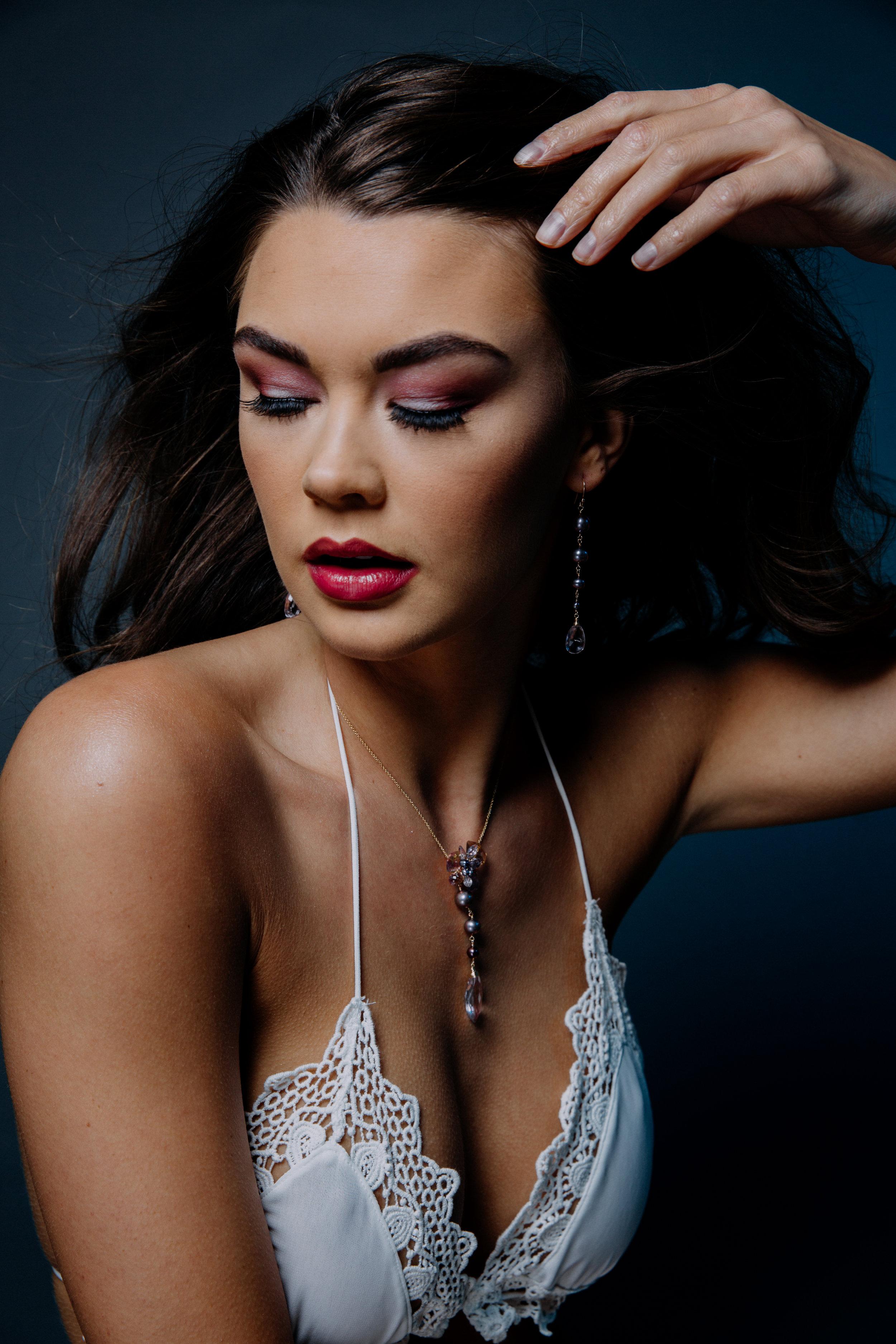 Model wearing pearl and pink amethyst drop earrings