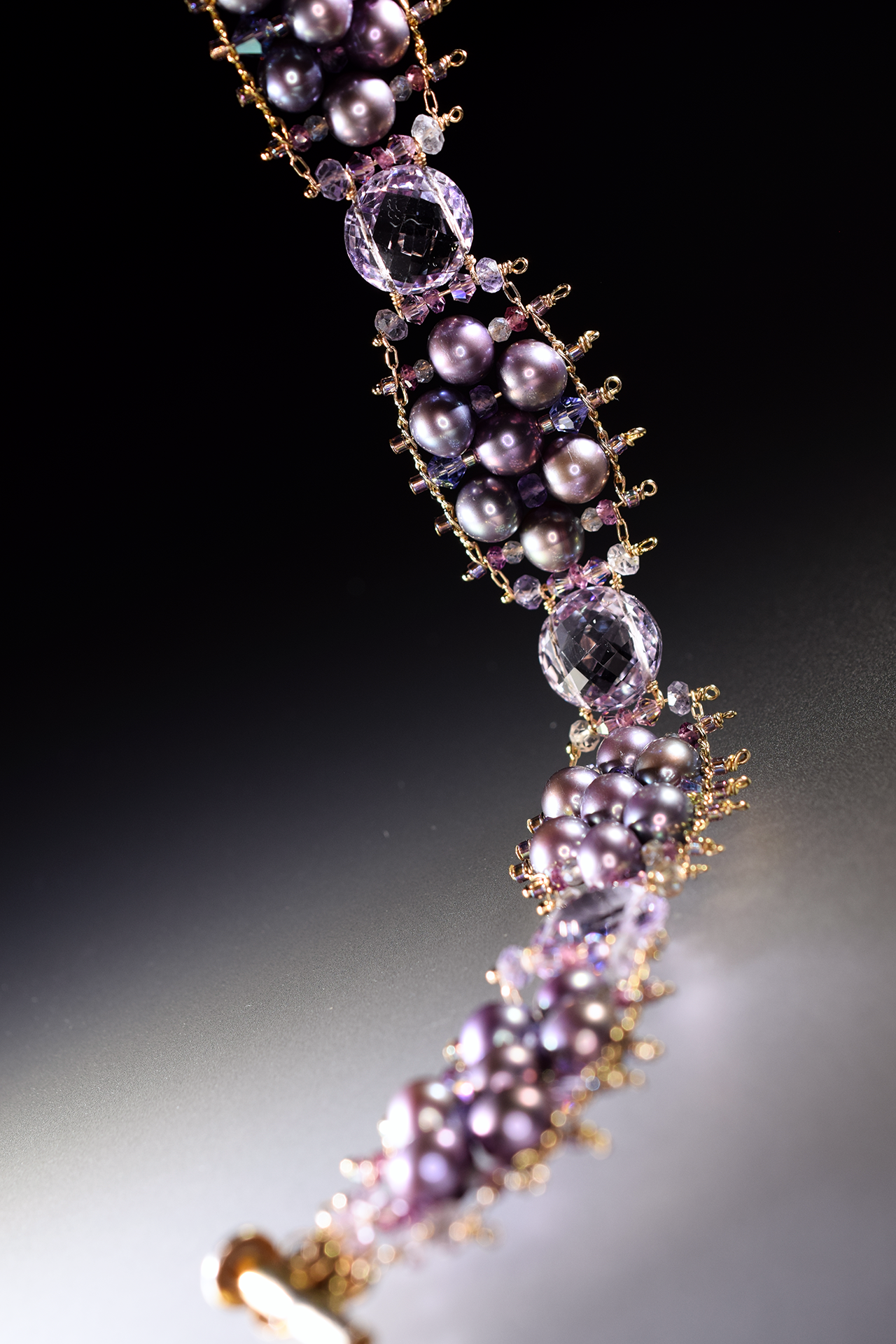 details of a pearl and pink amethyst bracelet