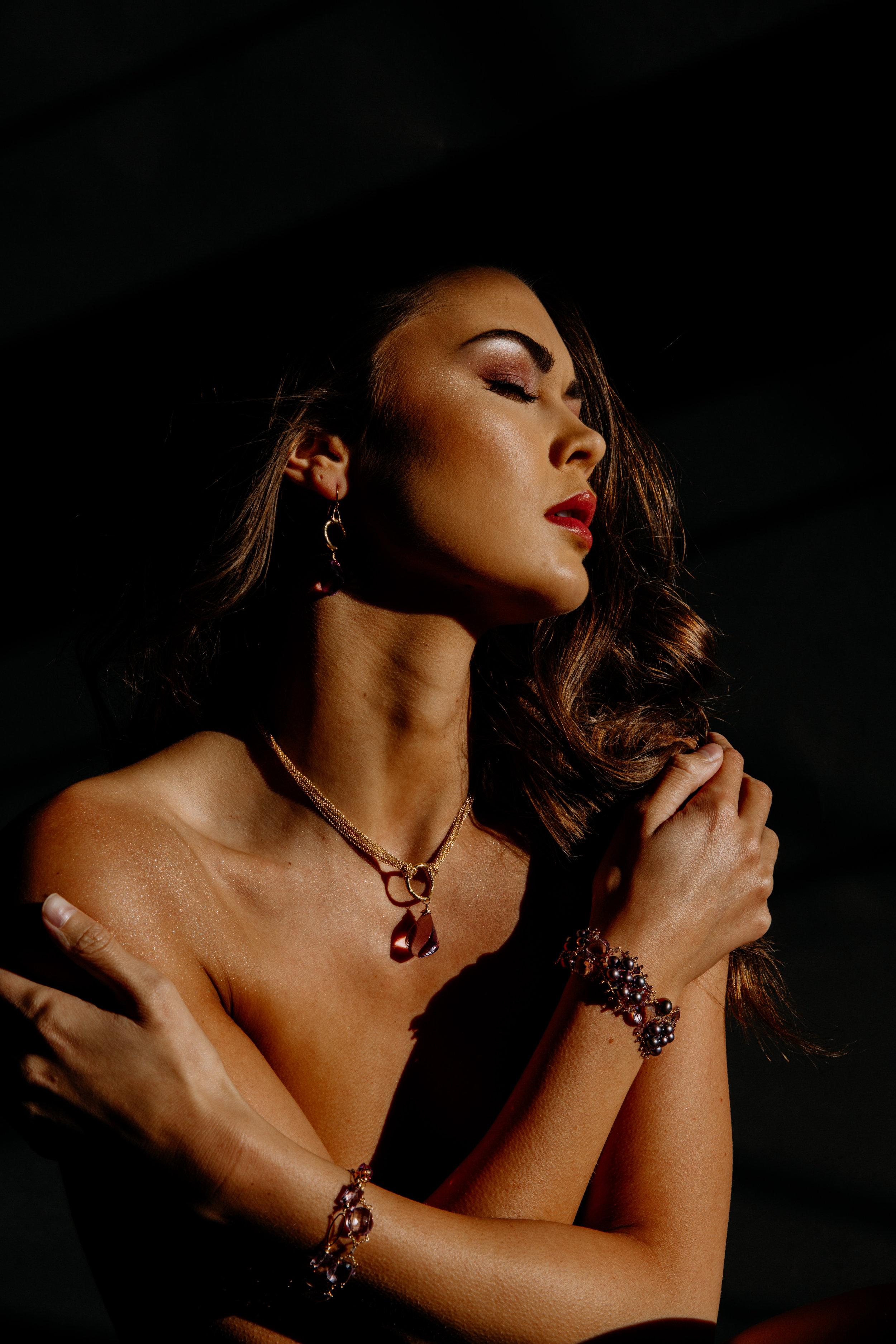 model wearing a pearl and pink amethyst bracelet