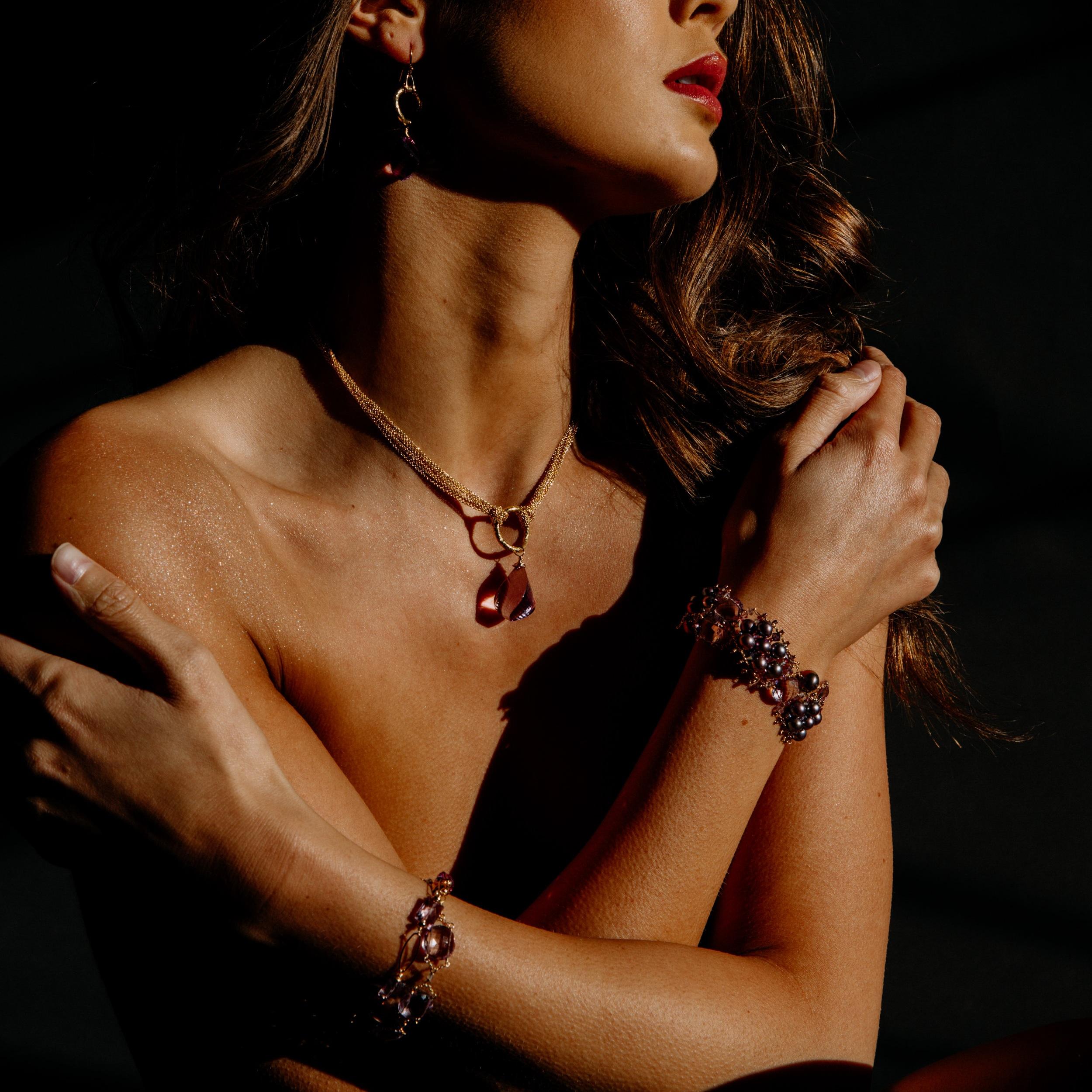 model wearing pink amethyst and labradorite bracelet