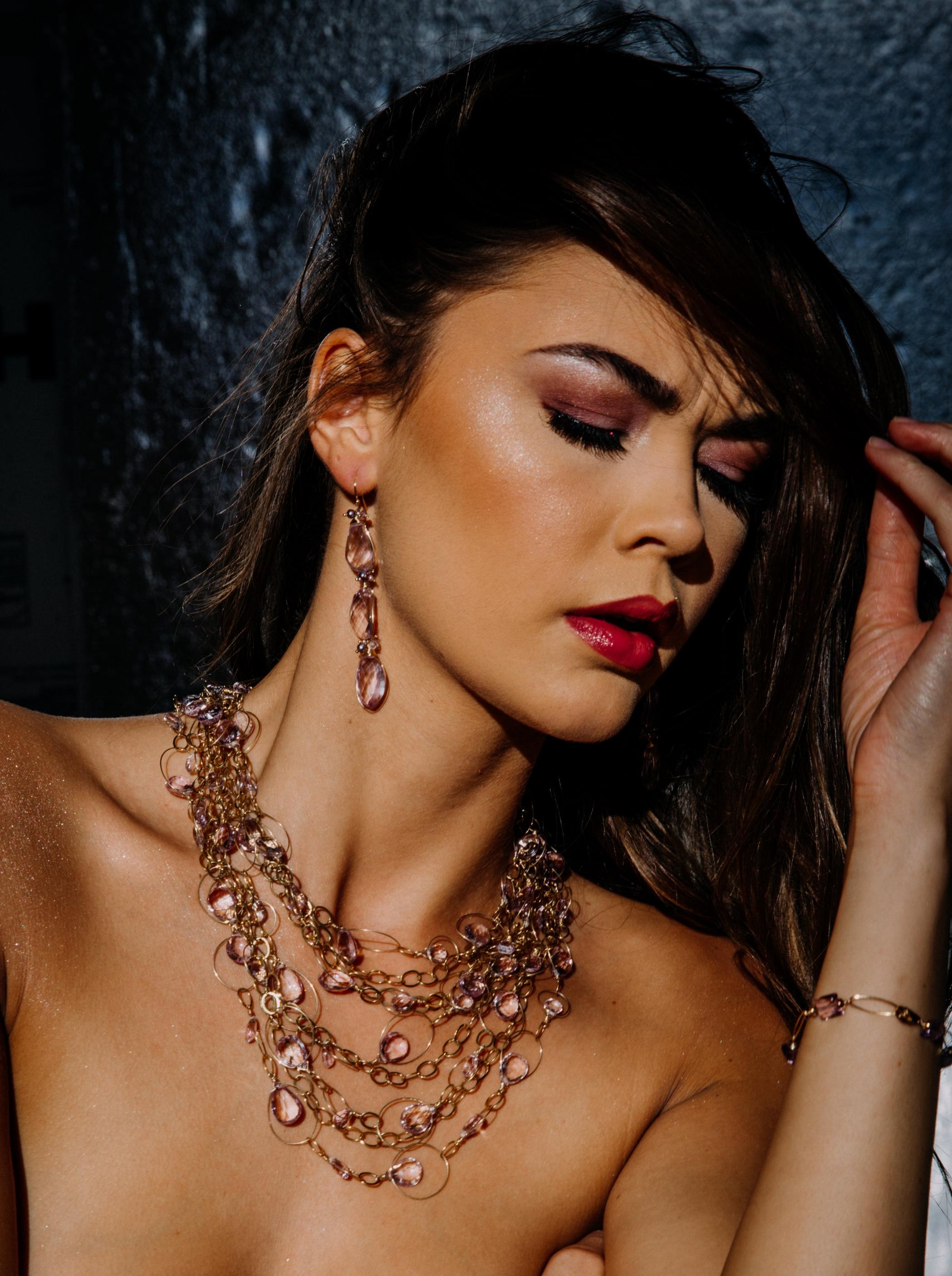 model wearing a pink amethyst multi strand gold link statement bib necklace