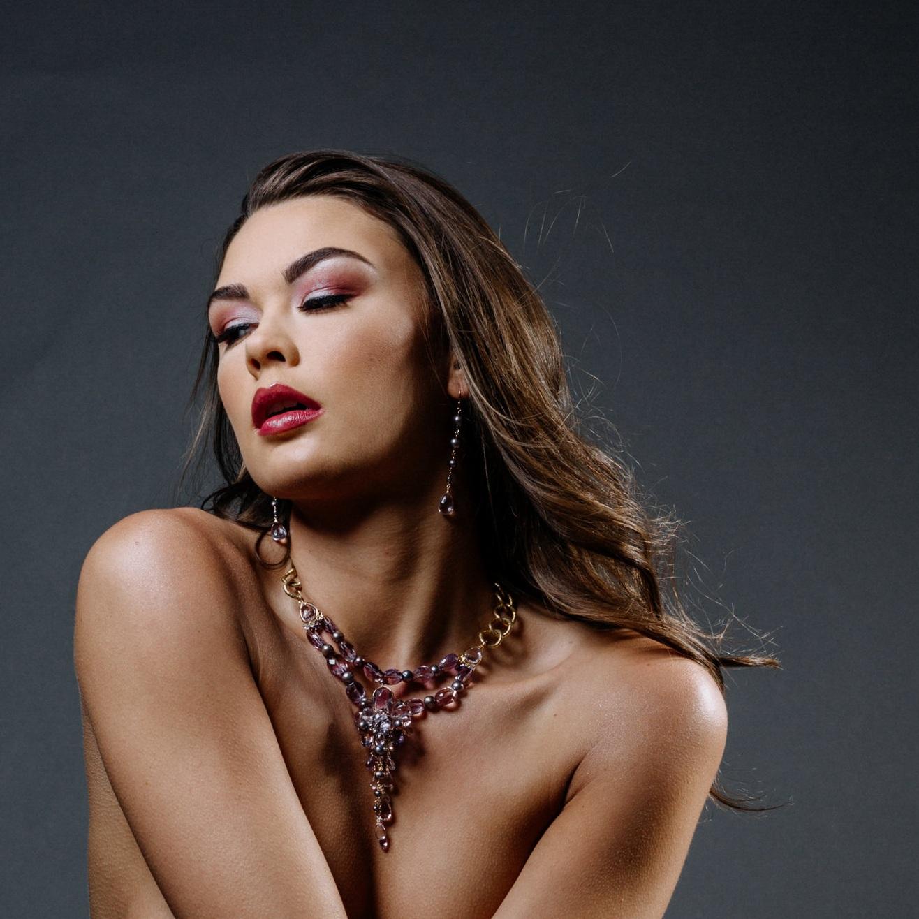 model wearing an ametrine, amethyst, pink amethyst, pearl multi drop statement necklace