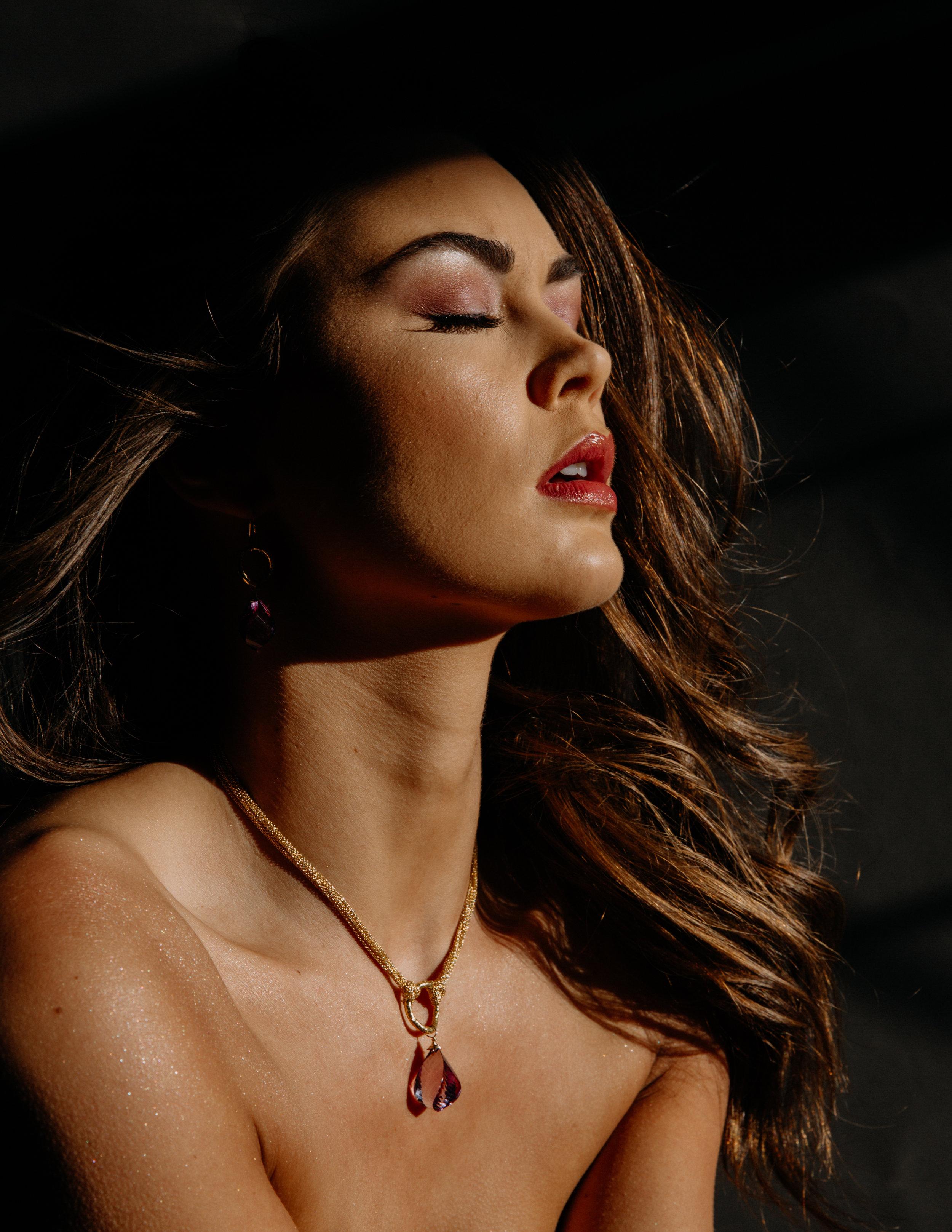 model wearing fancy cut amethyst drop earrings