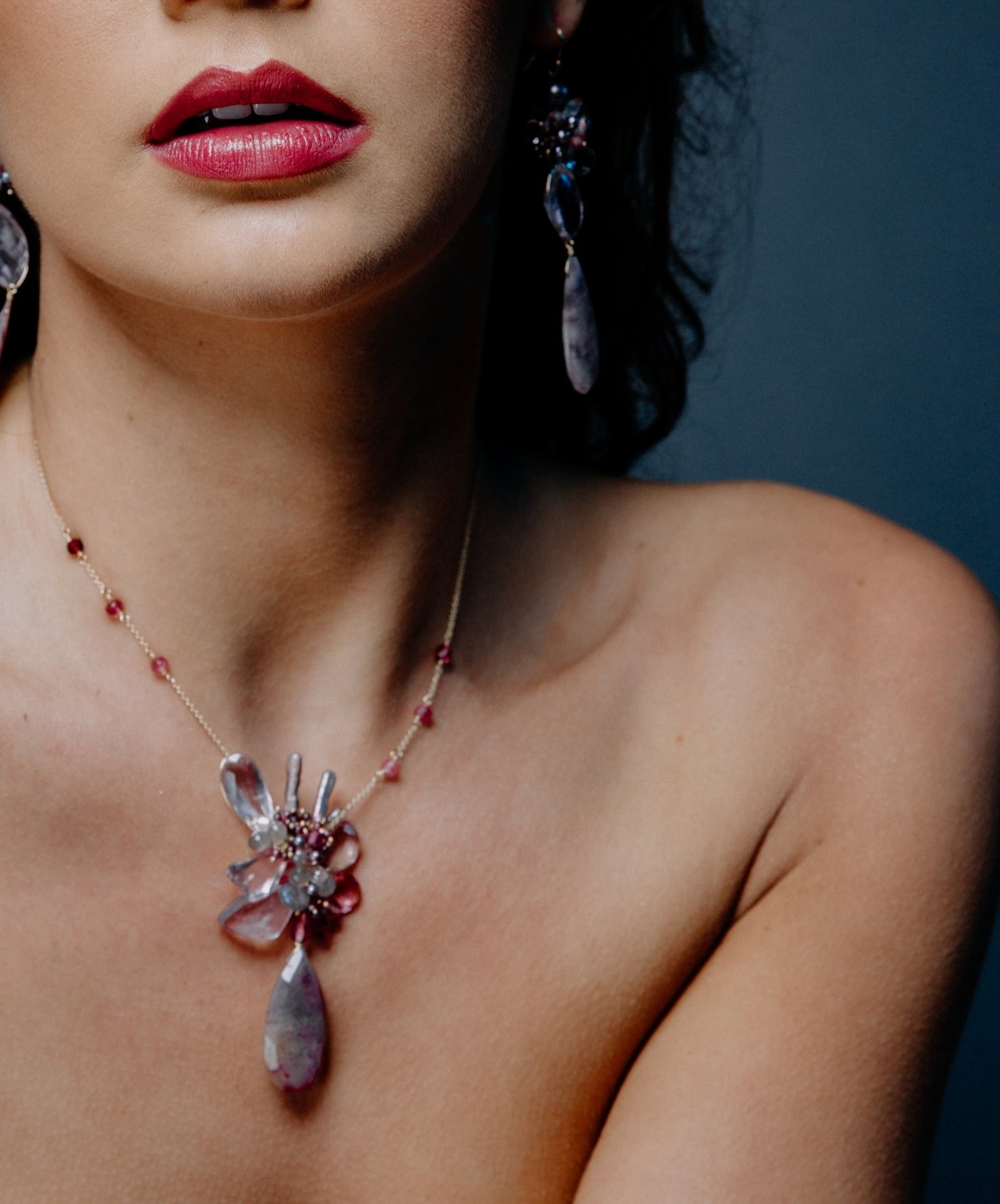 model wearing a pink amethyst pink tourmaline and sapphire drop pendant necklace