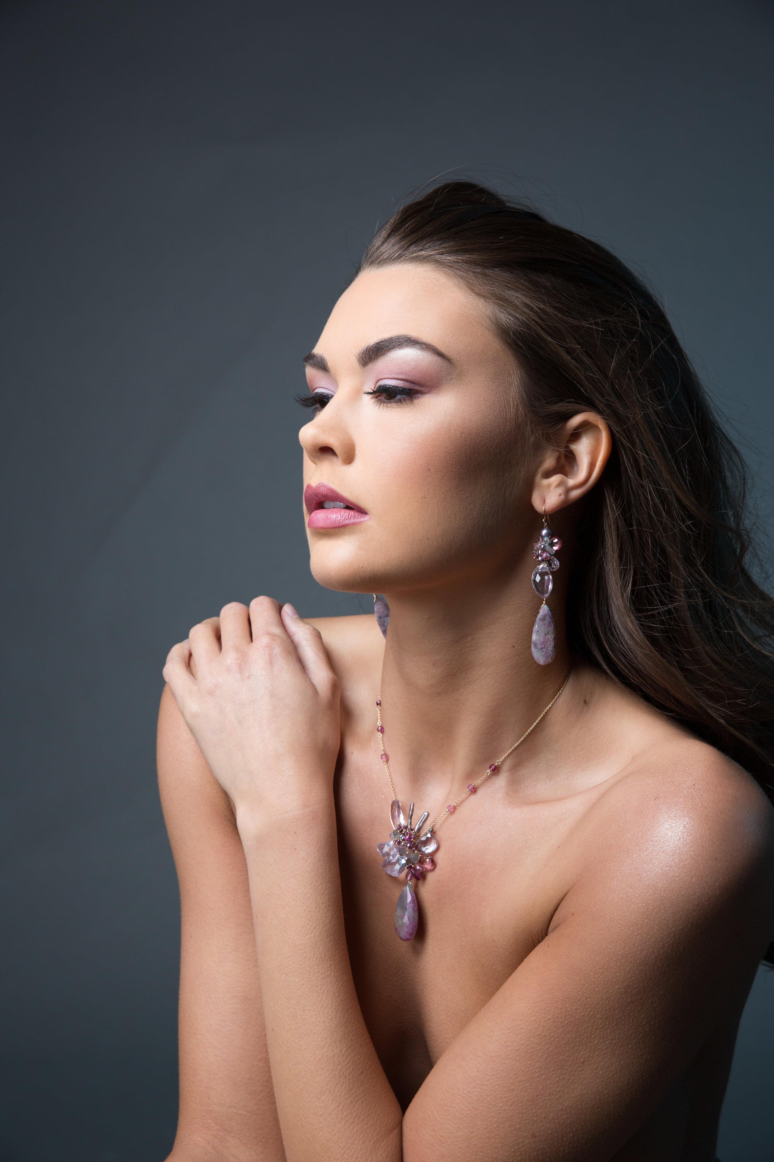 model wearing statement gemstone earrings