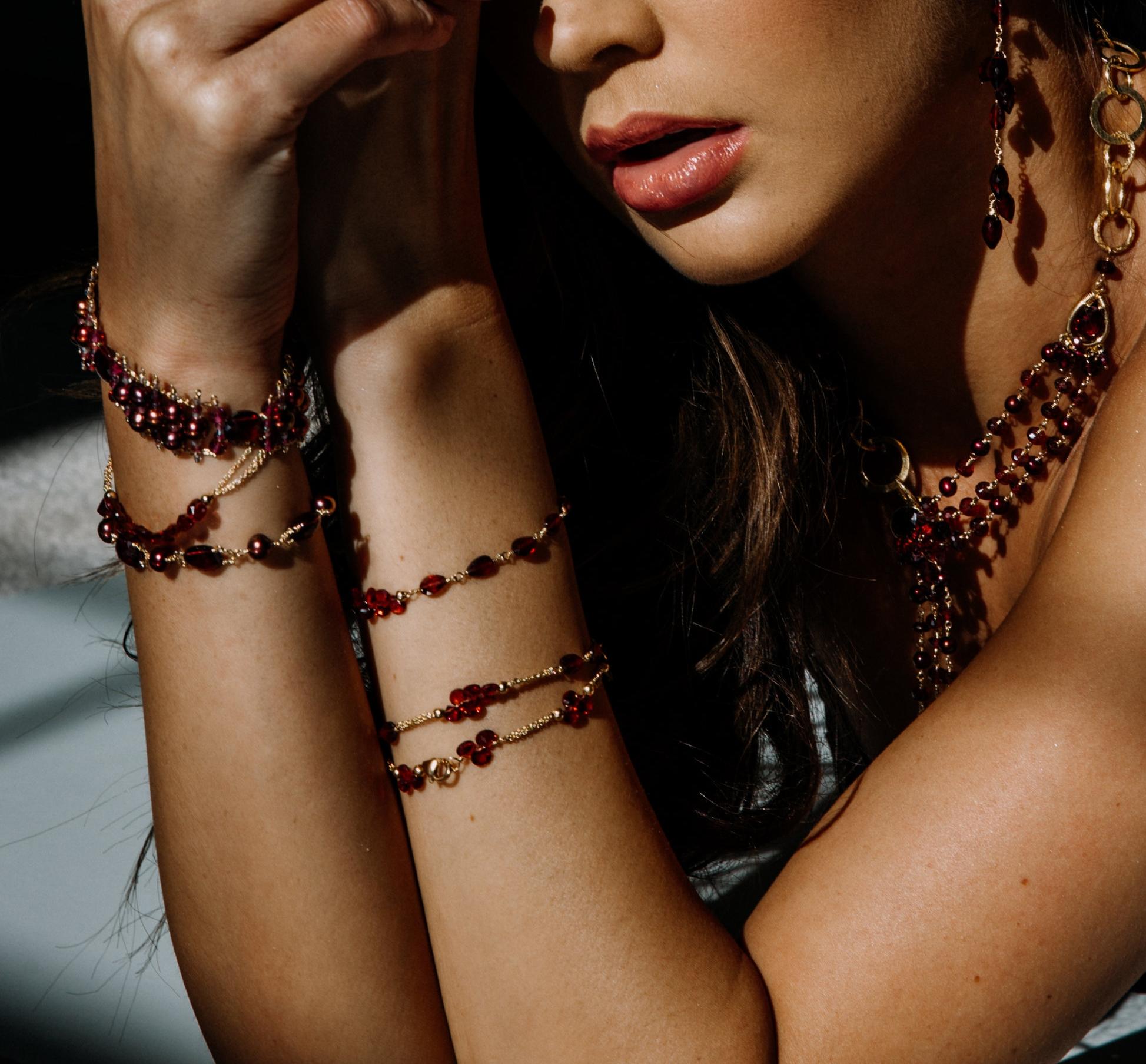 model wearing garnet layering bracelets