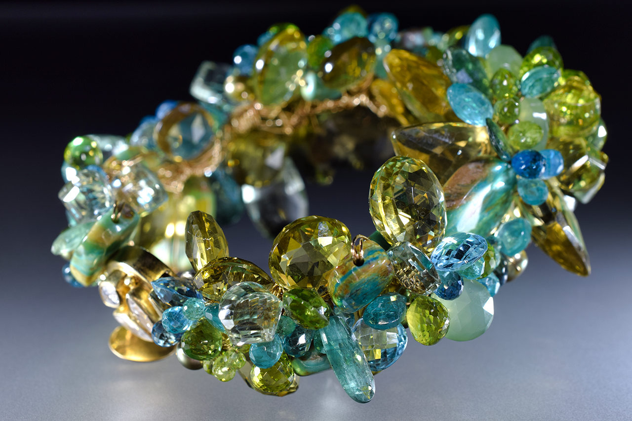 statement green and yellow gemstone and gold cuff bracelet