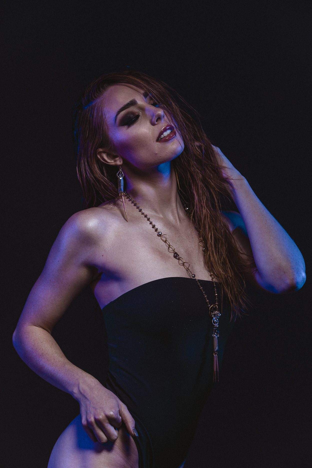 model wearing long multi drop gemstone pearl gold layering necklace