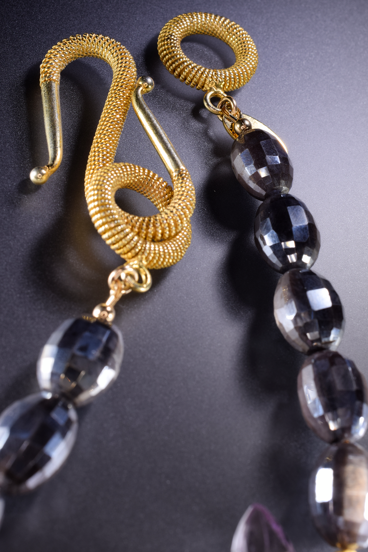 round faceted moonstone with side gemstone pearl gold accent