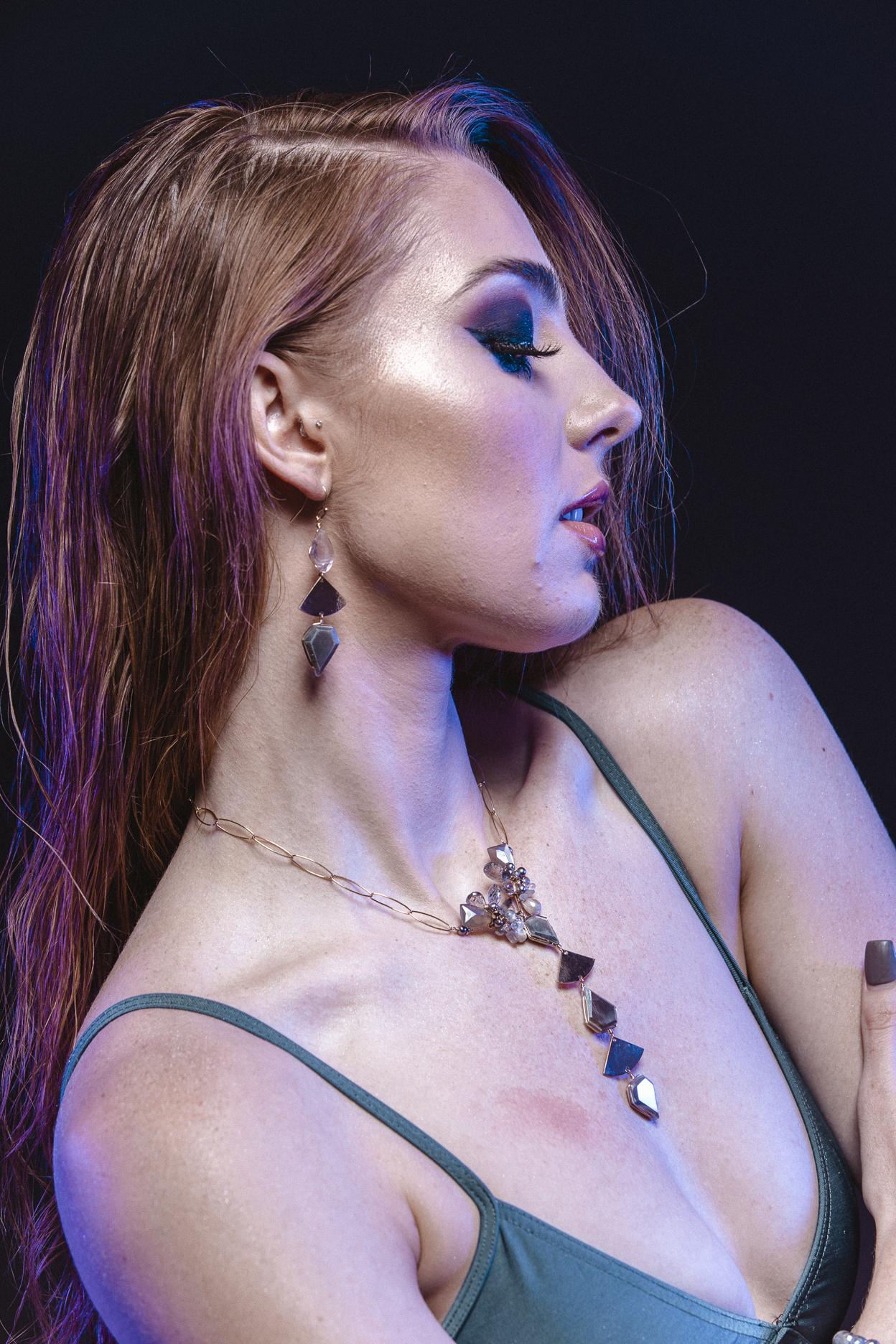 model wearing geometric triple short gemstone gold drop earrings