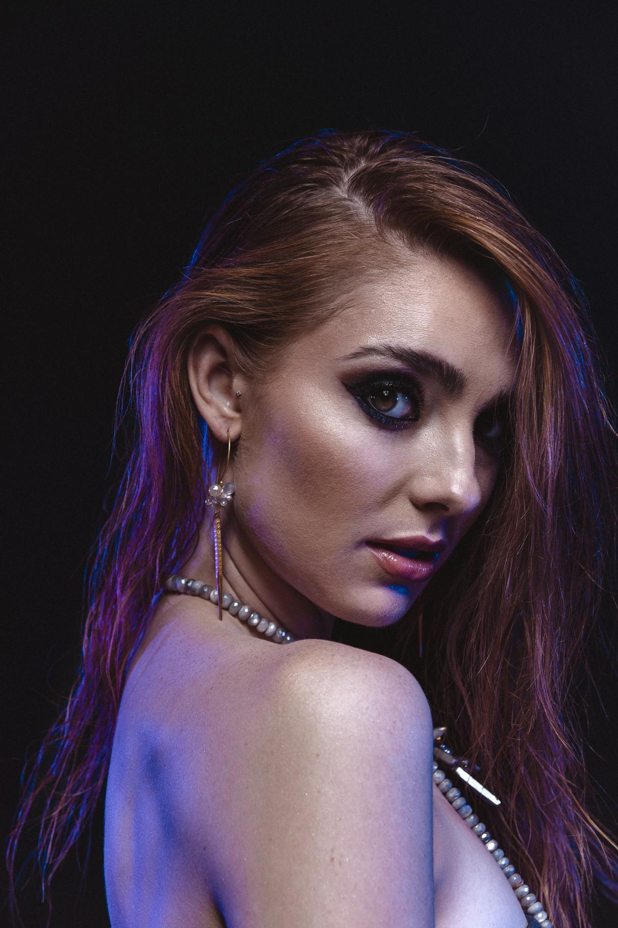 model wearing single gold spike gemstone cluster earrings