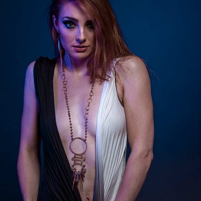 model wearing Multi circle gemstone and pearl encrusted drop pendant long gold necklace