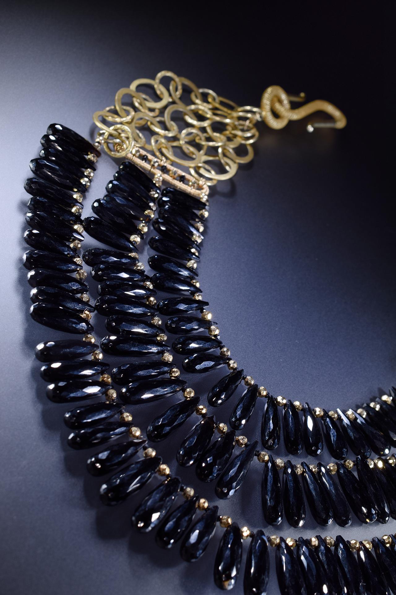 black spinel triple strand gold necklace