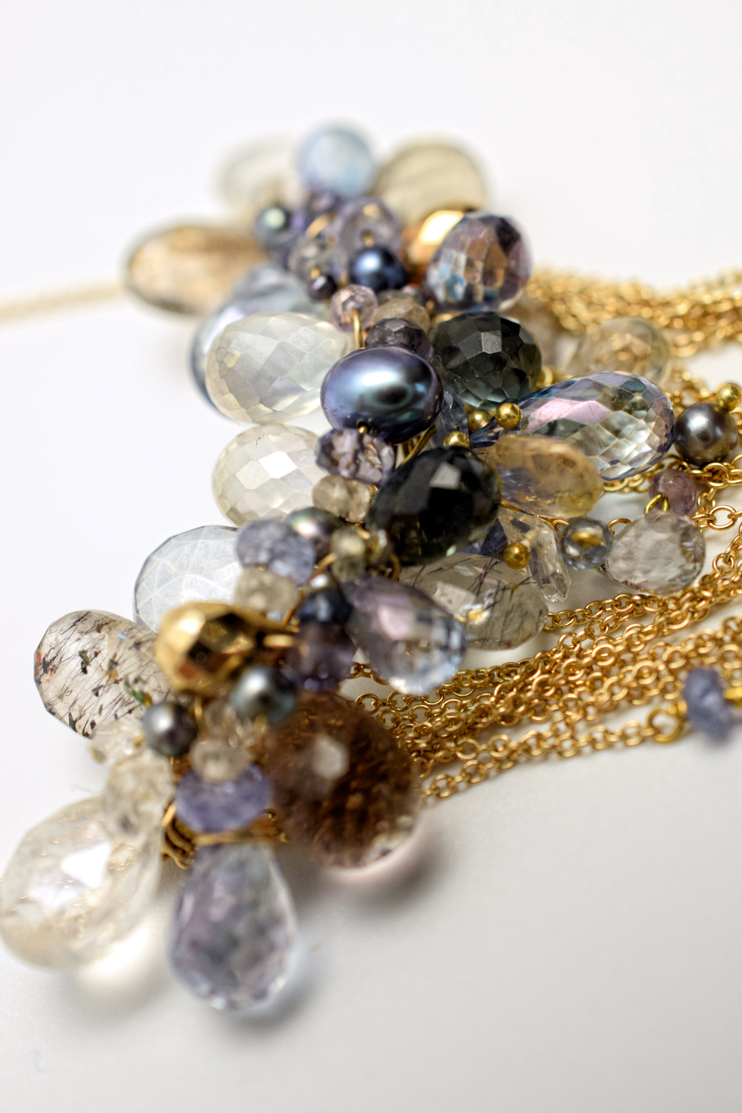 multi-drop gemstone necklace with delicate gold chains