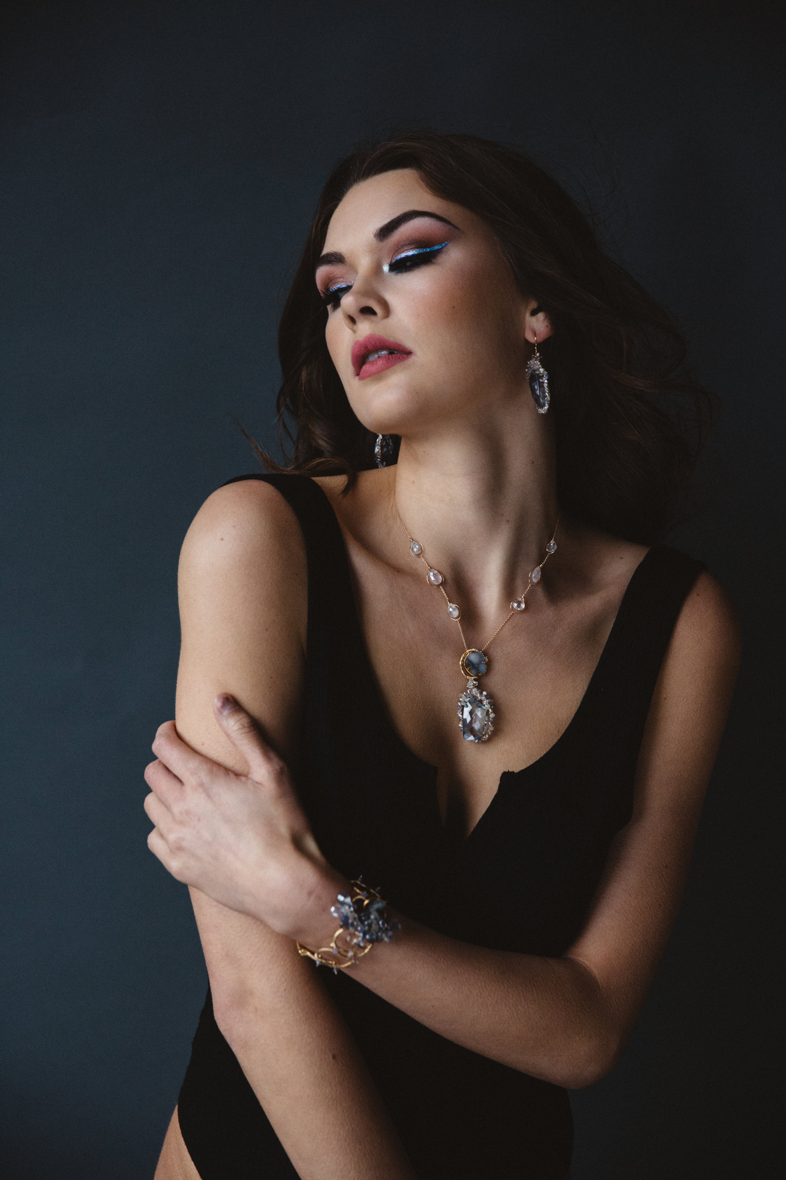 model wearing sapphire and druzy pendant necklace