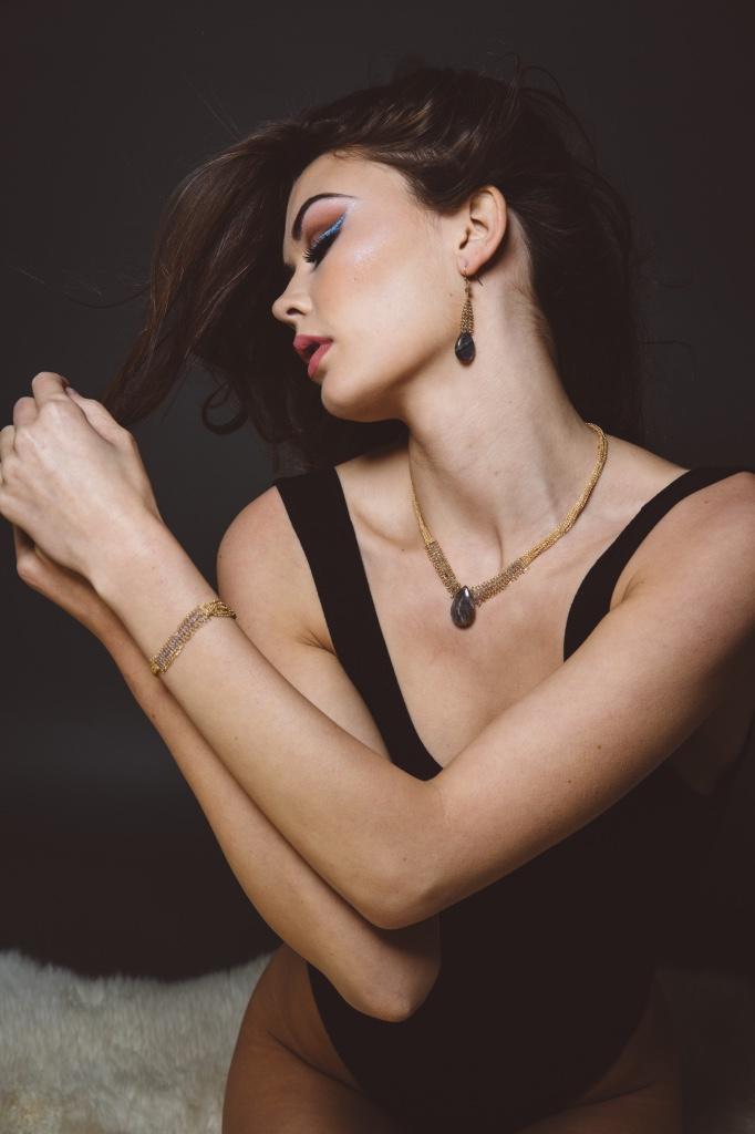 model wearing labradorite chain woven earrings