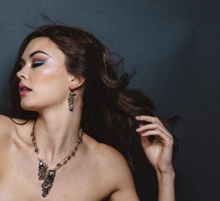 model wearing gemstone earrings